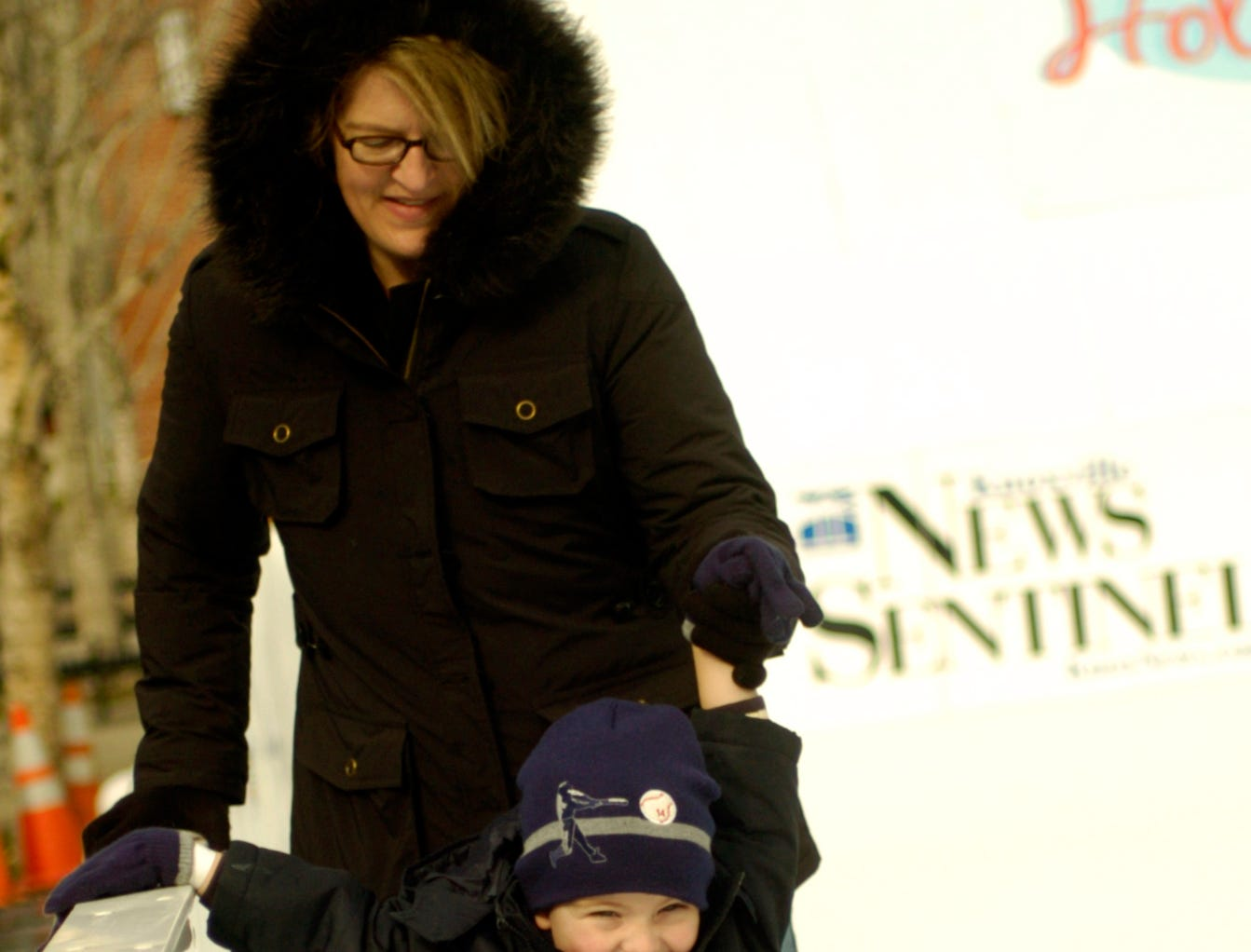 "Downtown resident Stacy Stewart helps her her son Zak Terry, 4, navigate across the ice Sunday where ice-skating has returned to Market Square after a 14-year absence. The The 36-by-100-foot ""Holidays on Ice"" rink is part of Knoxville' s ""Christmas in the City"" and will be open through New Year's Day except for Christmas Day. 2005"