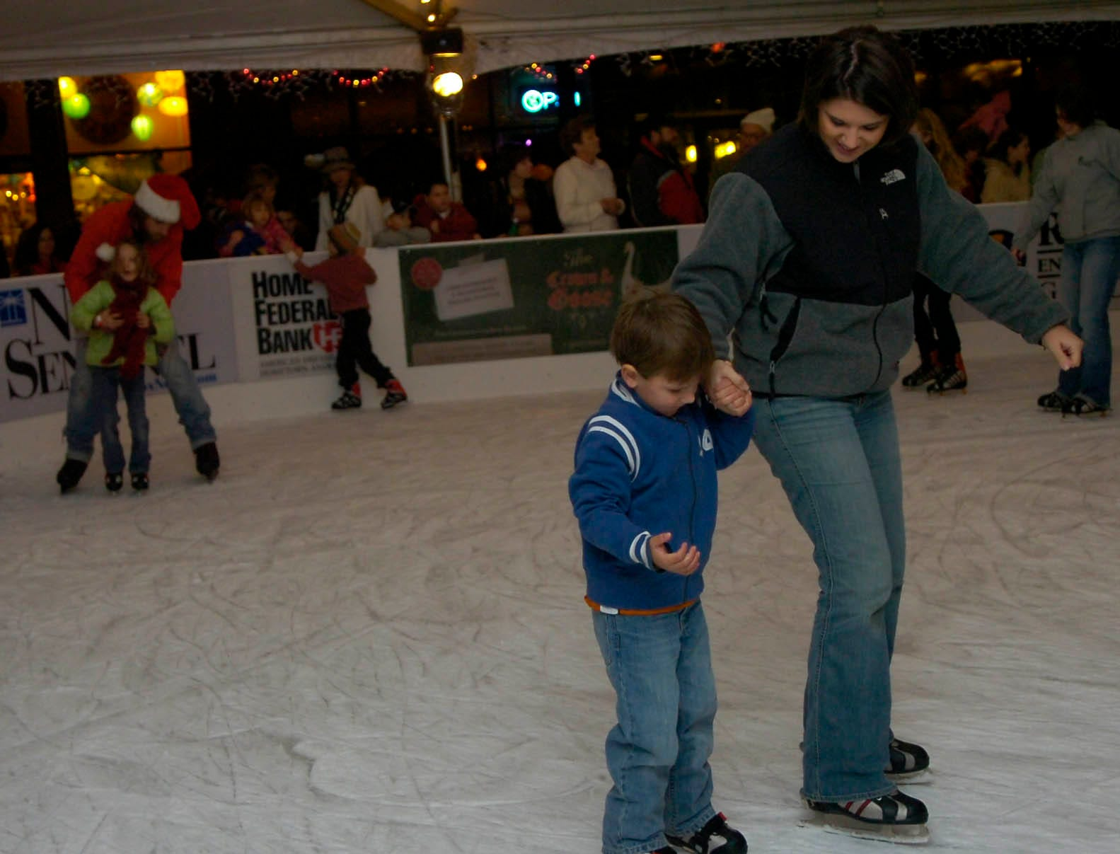 Carrie Turrill skates with five year-old Brandt Turrill (cq) at the Knoxville Holiday's on Ice rink during the Regal Celebration of Lights in downtown Knoxville on Friday.