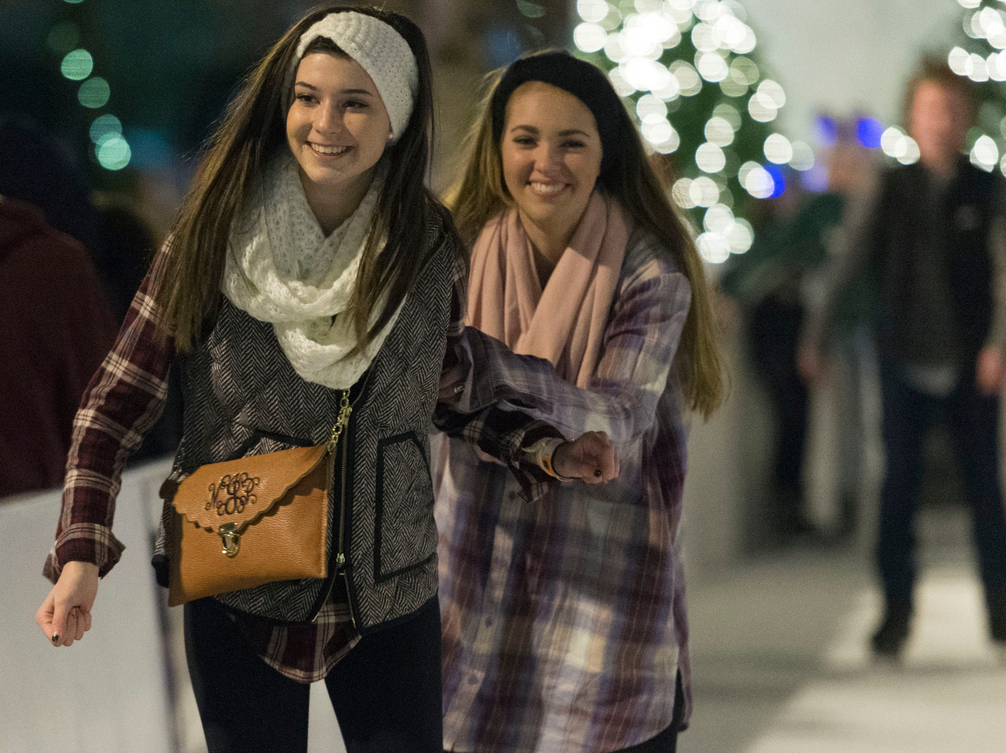Mallory Inman, left, and Grace Benson spend part of their New Year's Eve ice skating at Market Square, Thursday, December 31, 2015. The two are not staying out until midnight and plan to watch the Times Square's New Year's Eve celebration from the comfort of their home.