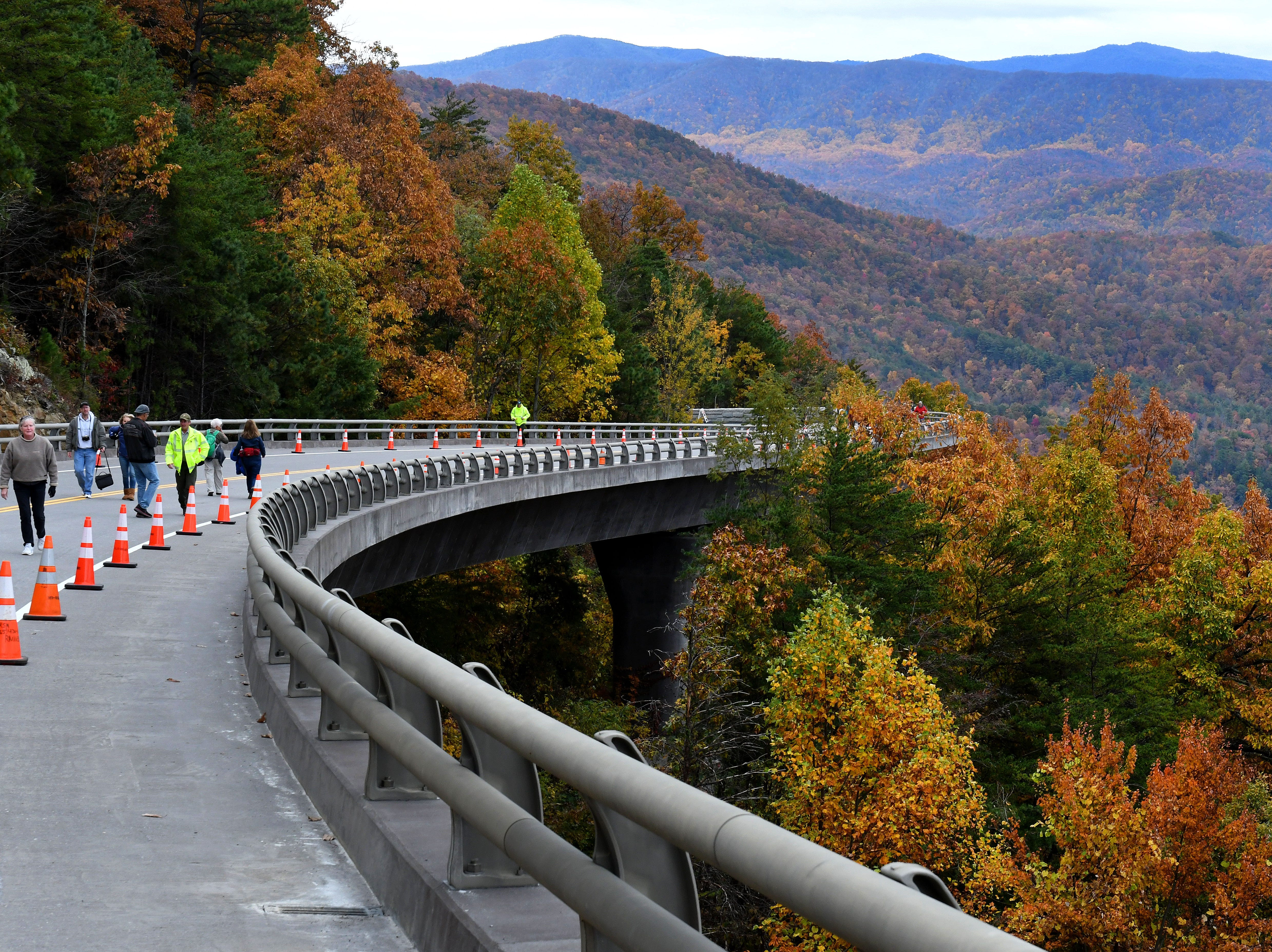 Visitors enjoy the National Park Service Community Day Thursday, Nov. 8, 2018 for the public to experience the bridges along the 1.65-mile section known as the 'Missing Link' before it opens to motorists and cyclists Saturday.