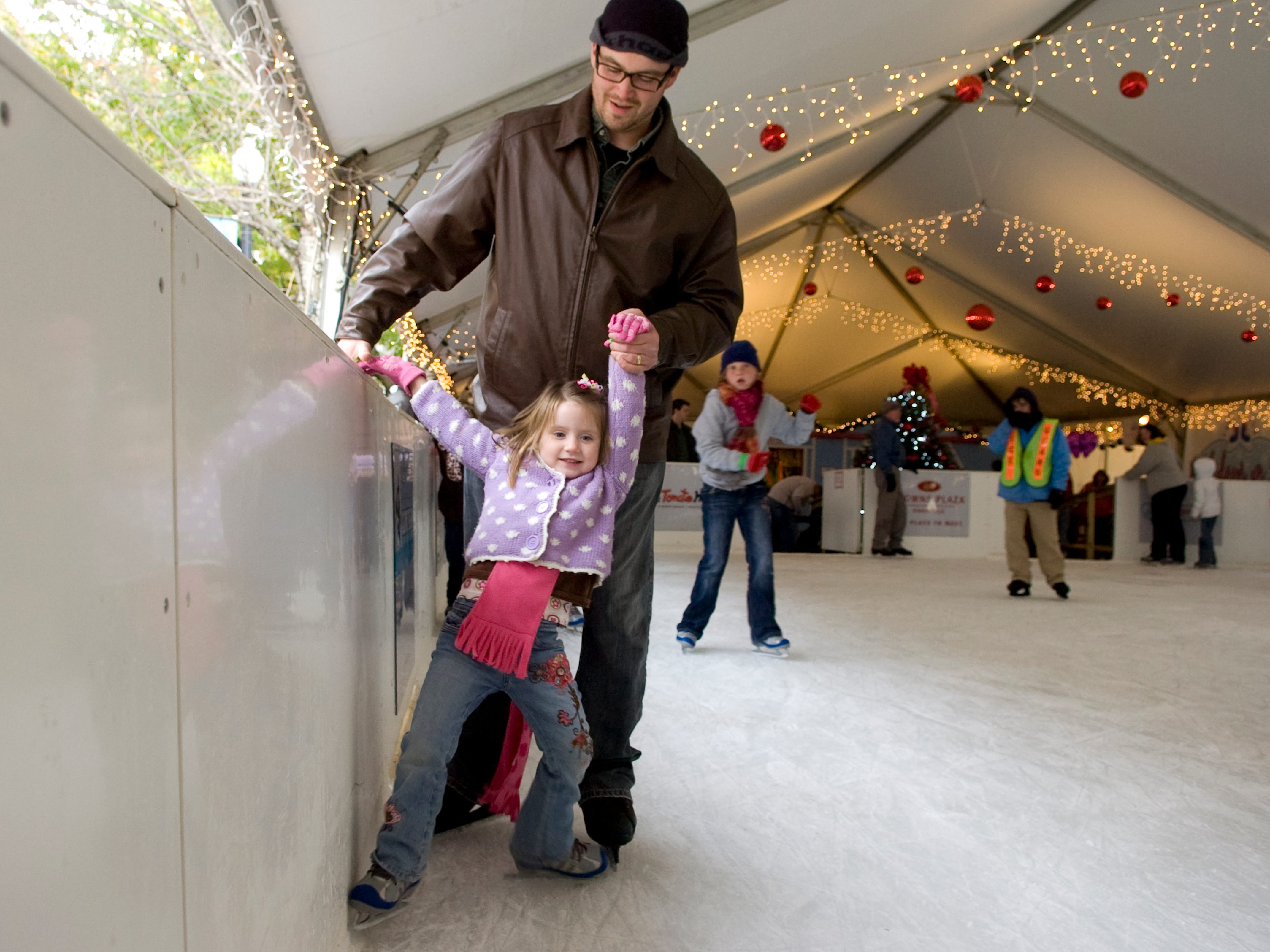 Anthony Johnson helps his daughter Rylee, 4, keep her balance  while ice skating at Knoxville's Holiday on Ice skating on Friday, November 26, 2010.