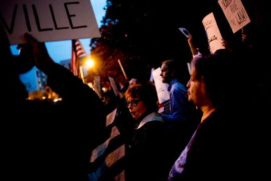 Protesters chant during a protest against the firing of Attorney General Jeff Sessions in Knoxville on Thursday.