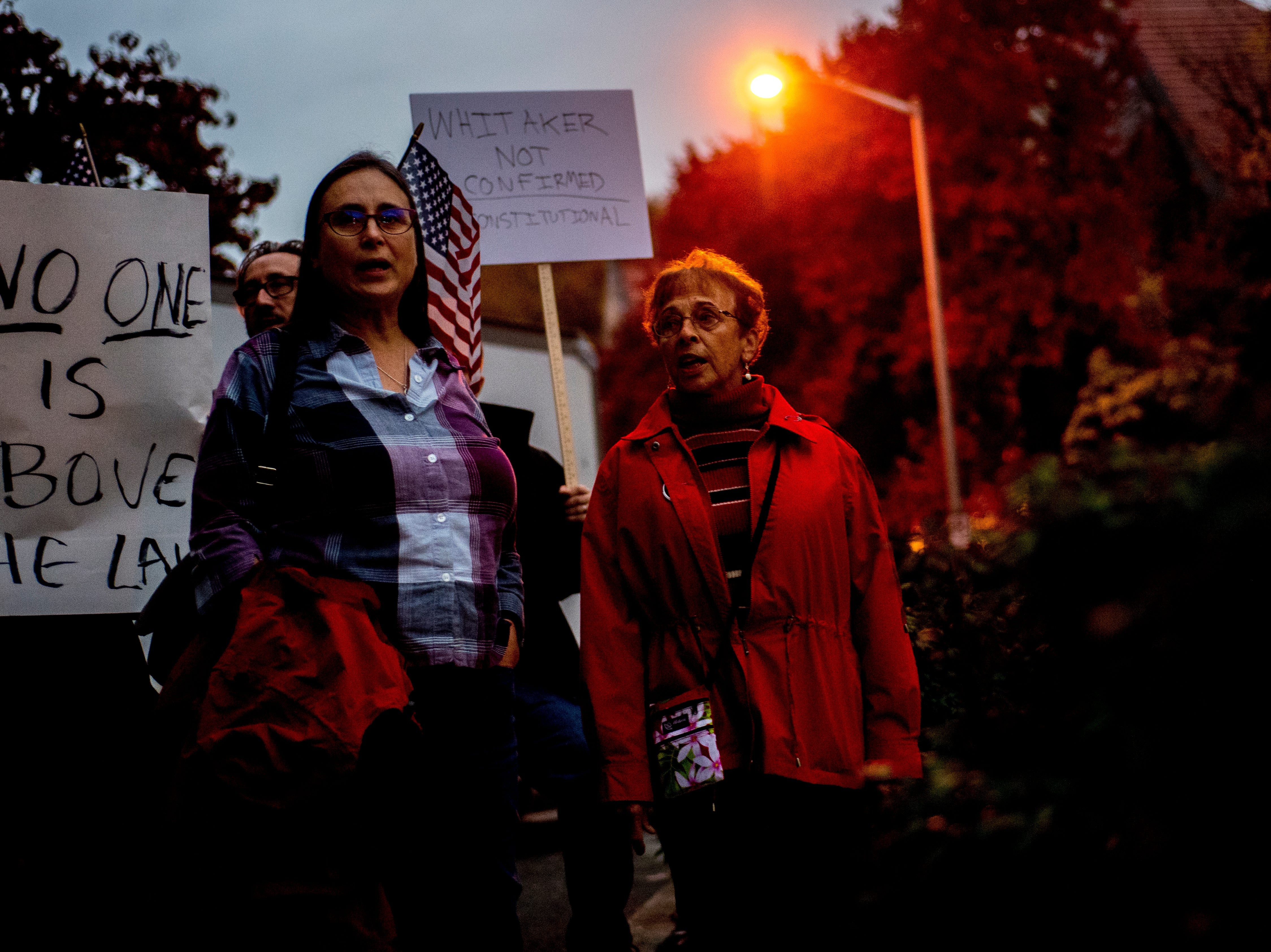 Leah Patterson, visiting from California, left, and Kathy Decker, of Norris, chant during a protest against the firing of United States Attorney General Jeff Sessions outside of the Federal Courthouse in Knoxville, Tennessee on Thursday, November 8, 2018.