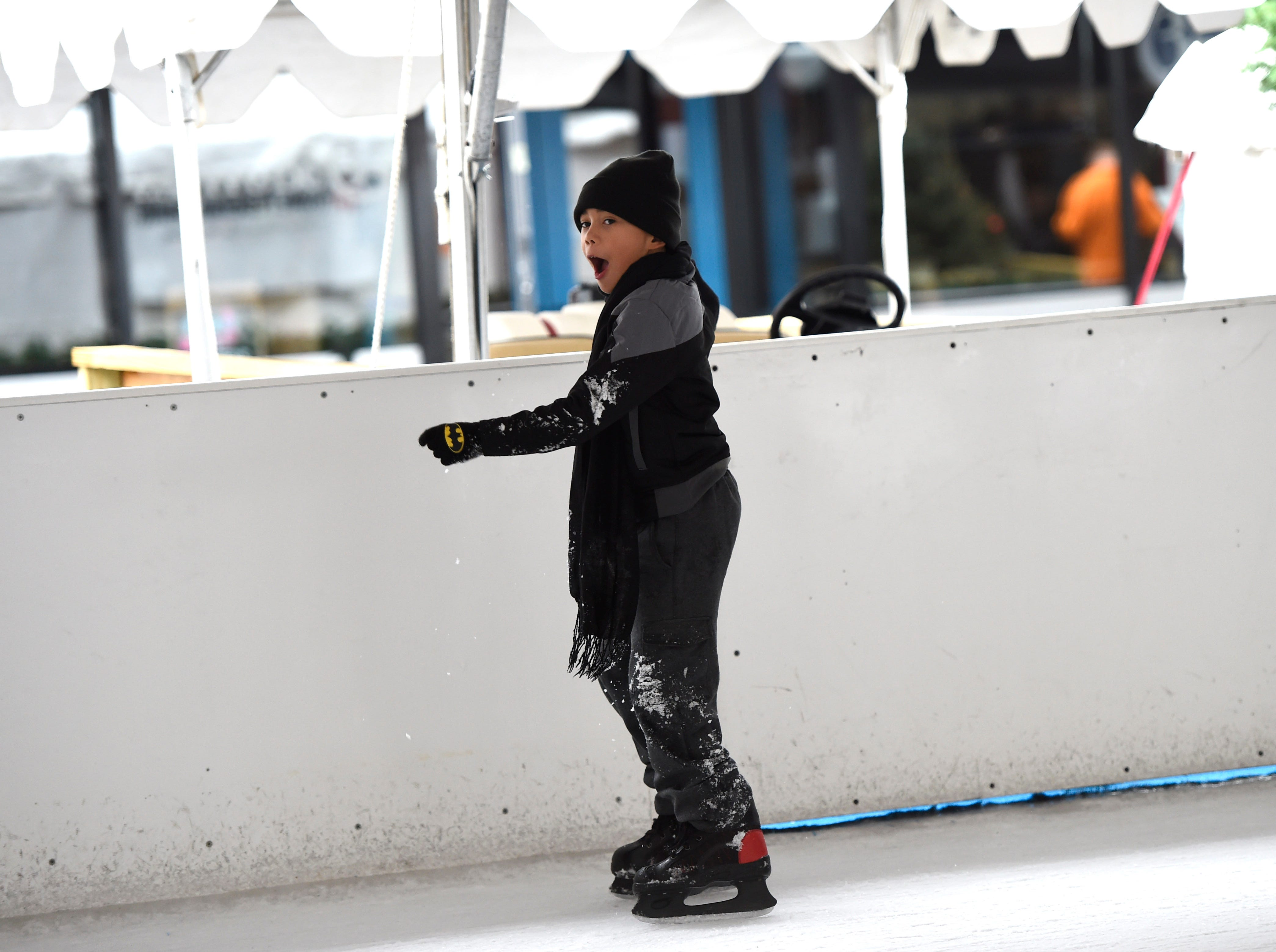 Malachi Kirk ice skates for the first time in Market Square on Christmas Eve, Wednesday, Dec. 24, 2014.