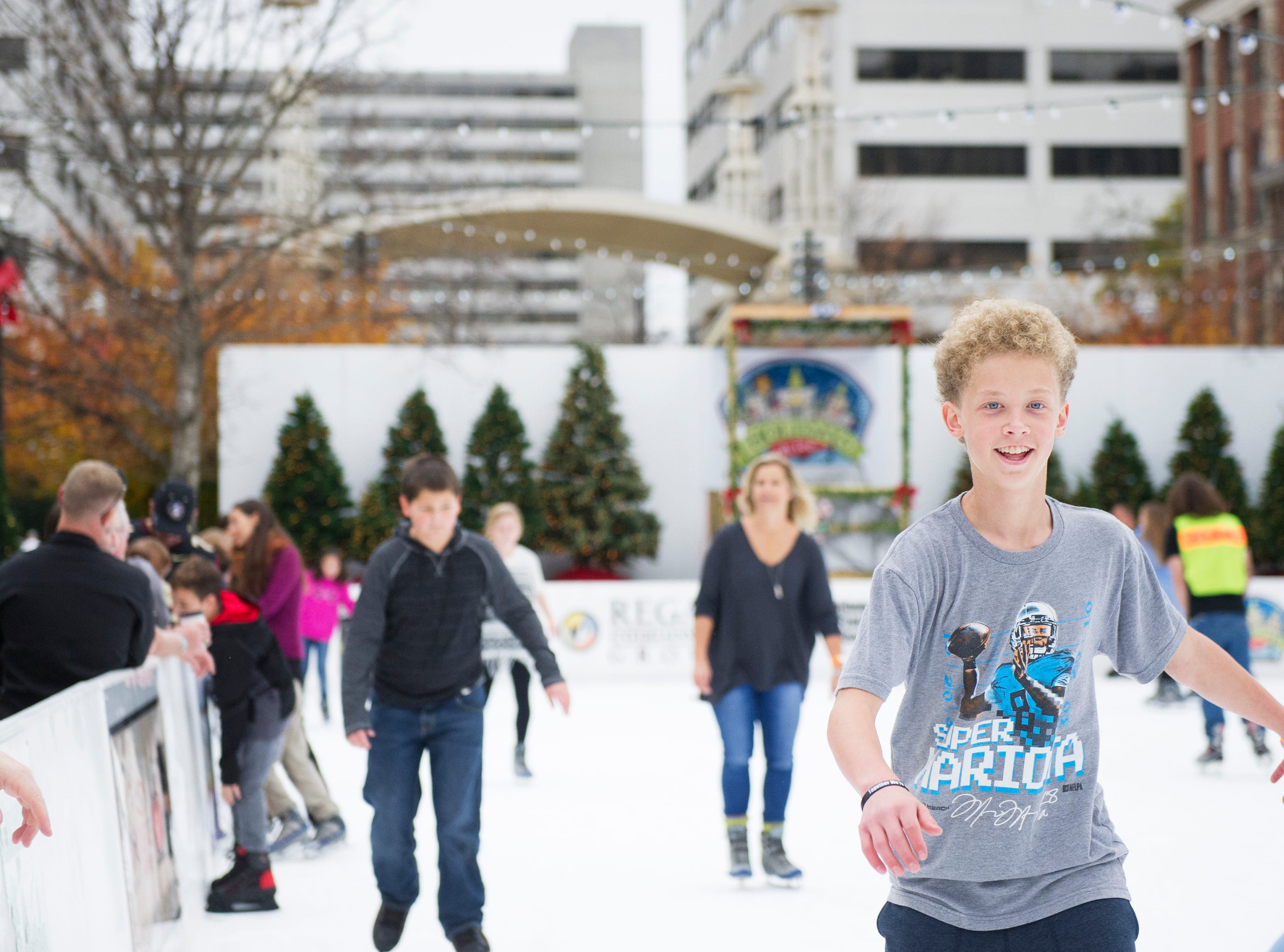 Charlie Rice of Knoxville ice skates in the warm November weather during opening weekend for the Market Square ice skating rink Saturday, Nov. 28, 2015.