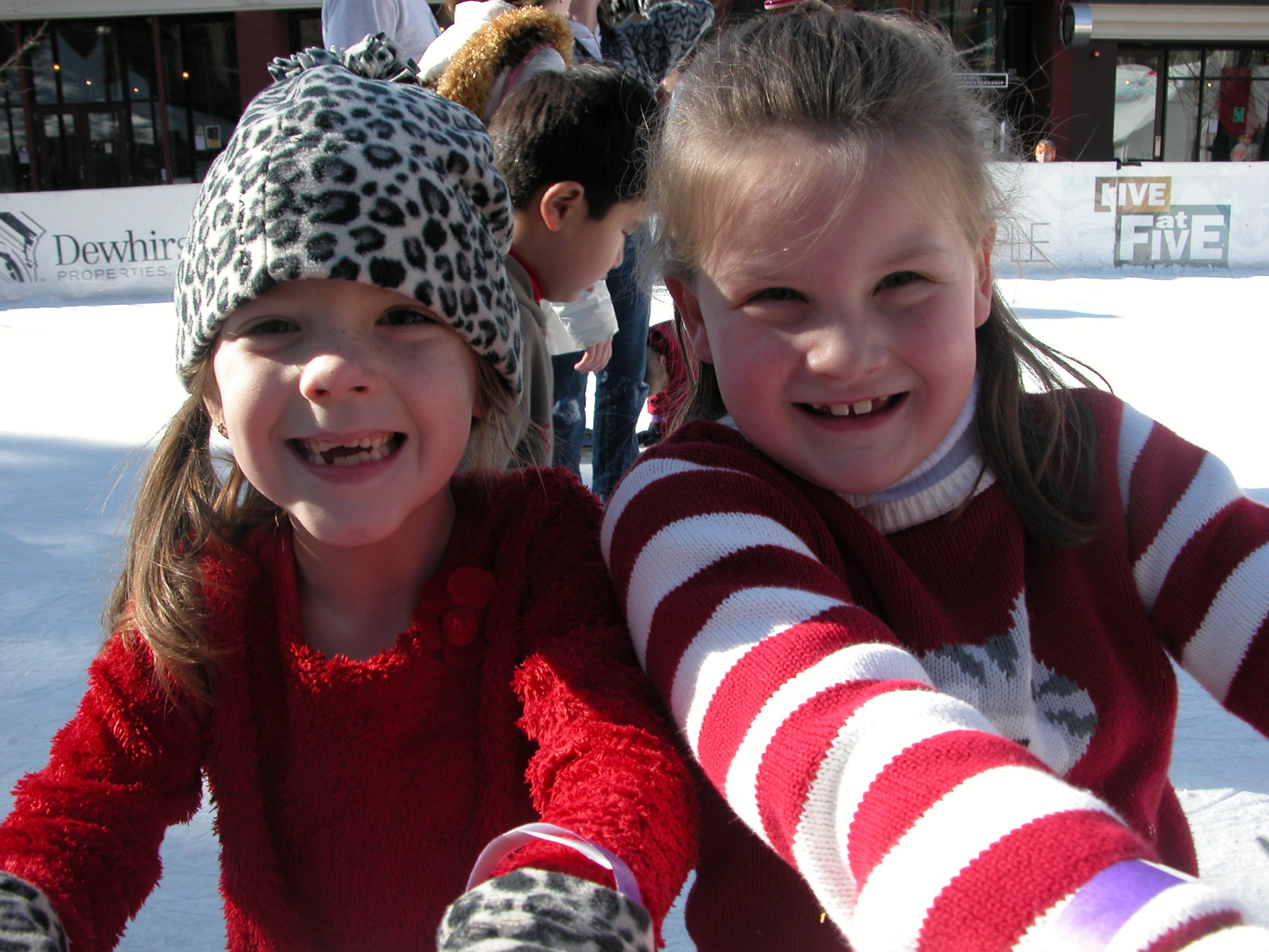 Jenna Witt, 6, skates with her friend, Lauren Ferguson, 6, at the ice skating rink in Market Square Dec. 23. Jenna is the daughter of Jack and Julee Witt, and Lauren is the daughter of Jennifer and Shawn Little.