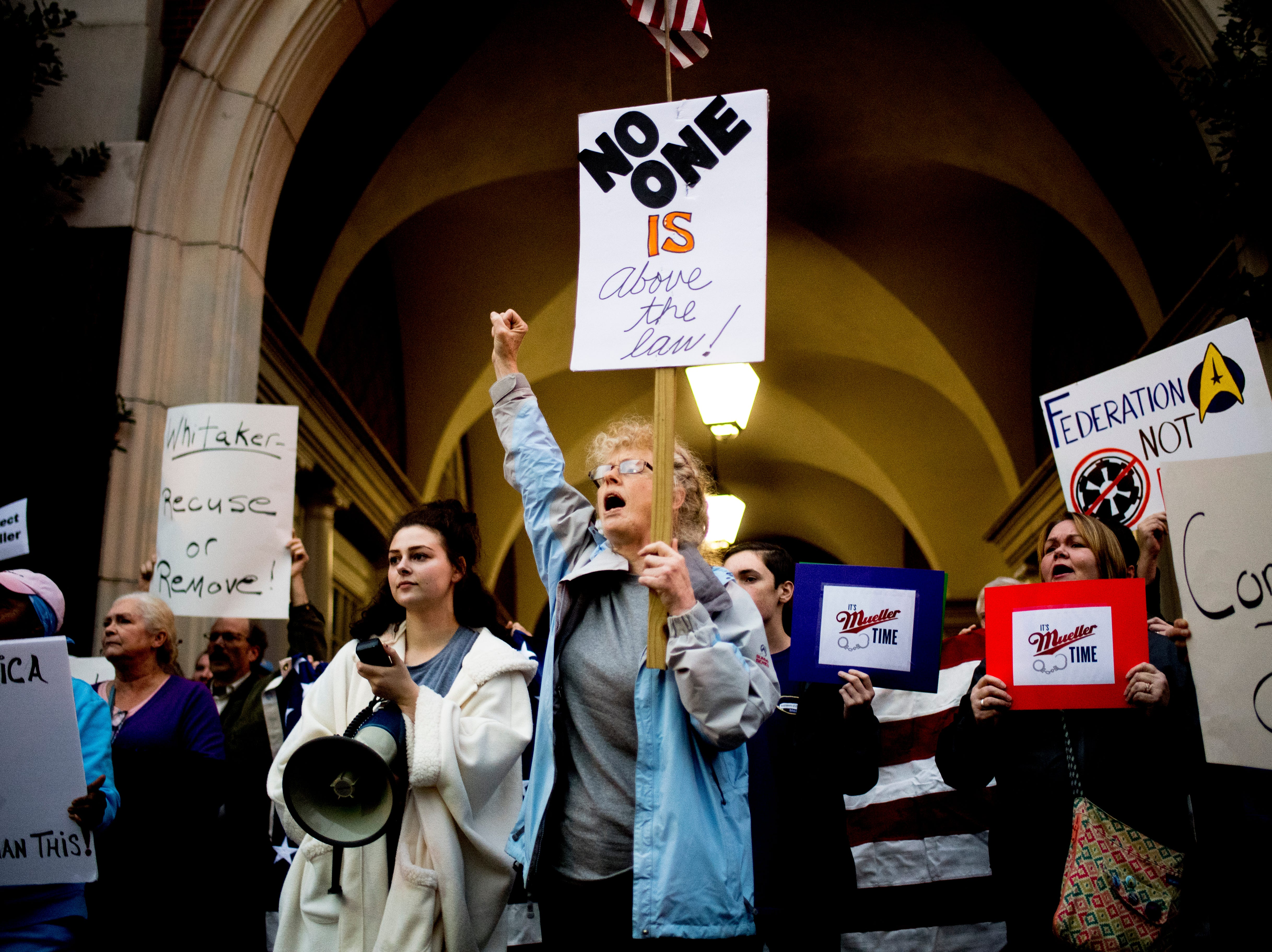 Linda Sharp, center, and her granddaughter Tori Sharp, both of Maryville, chant during a protest against the firing of United States Attorney General Jeff Sessions outside of the Federal Courthouse in Knoxville, Tennessee on Thursday, November 8, 2018.