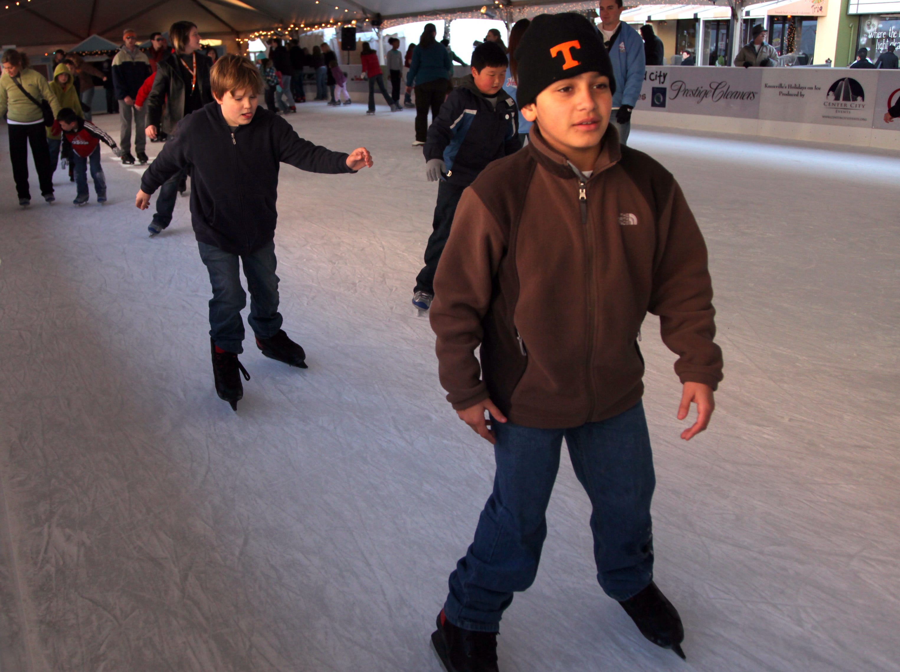 Camron Natour, right, and Camriunn Morgan, left, ice skate during Knoxville's Holidays on Ice on Market Square on Friday, Nov. 27, 2009.