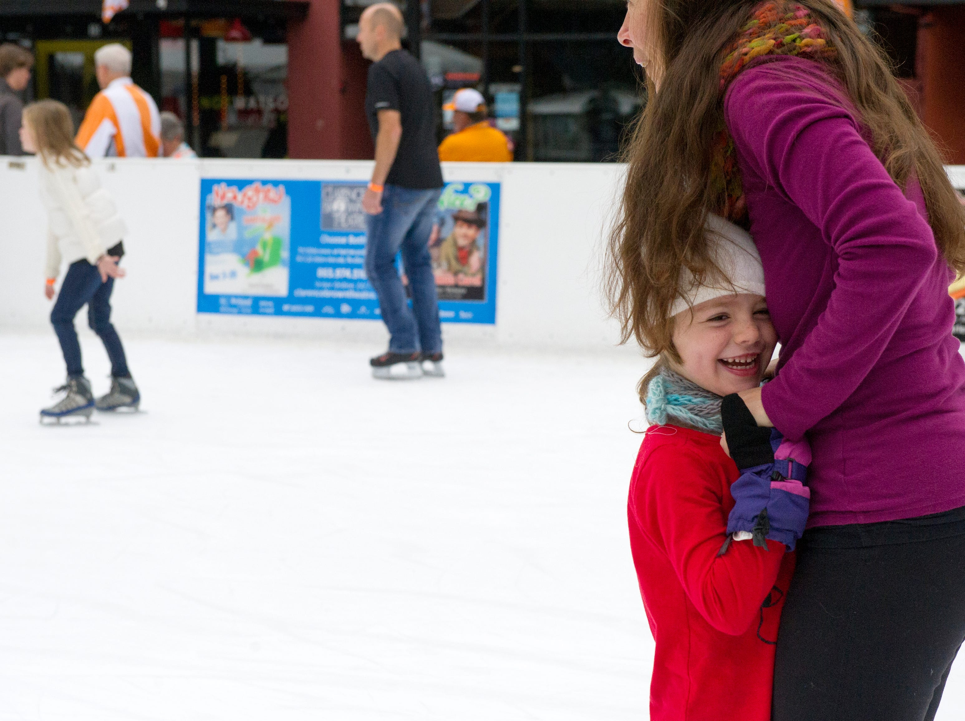 Liv Brace, 5, hugs her mom Gina Brace of Knoxville while learning how to skate during opening weekend for the Market Square ice skating rink Saturday, Nov. 28, 2015.