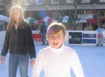 Carter/Strawberry Plains-area resident Ciarra Light, left, teaches her sister, Karly Light, to skate at the Market Square ice skating rink recently.