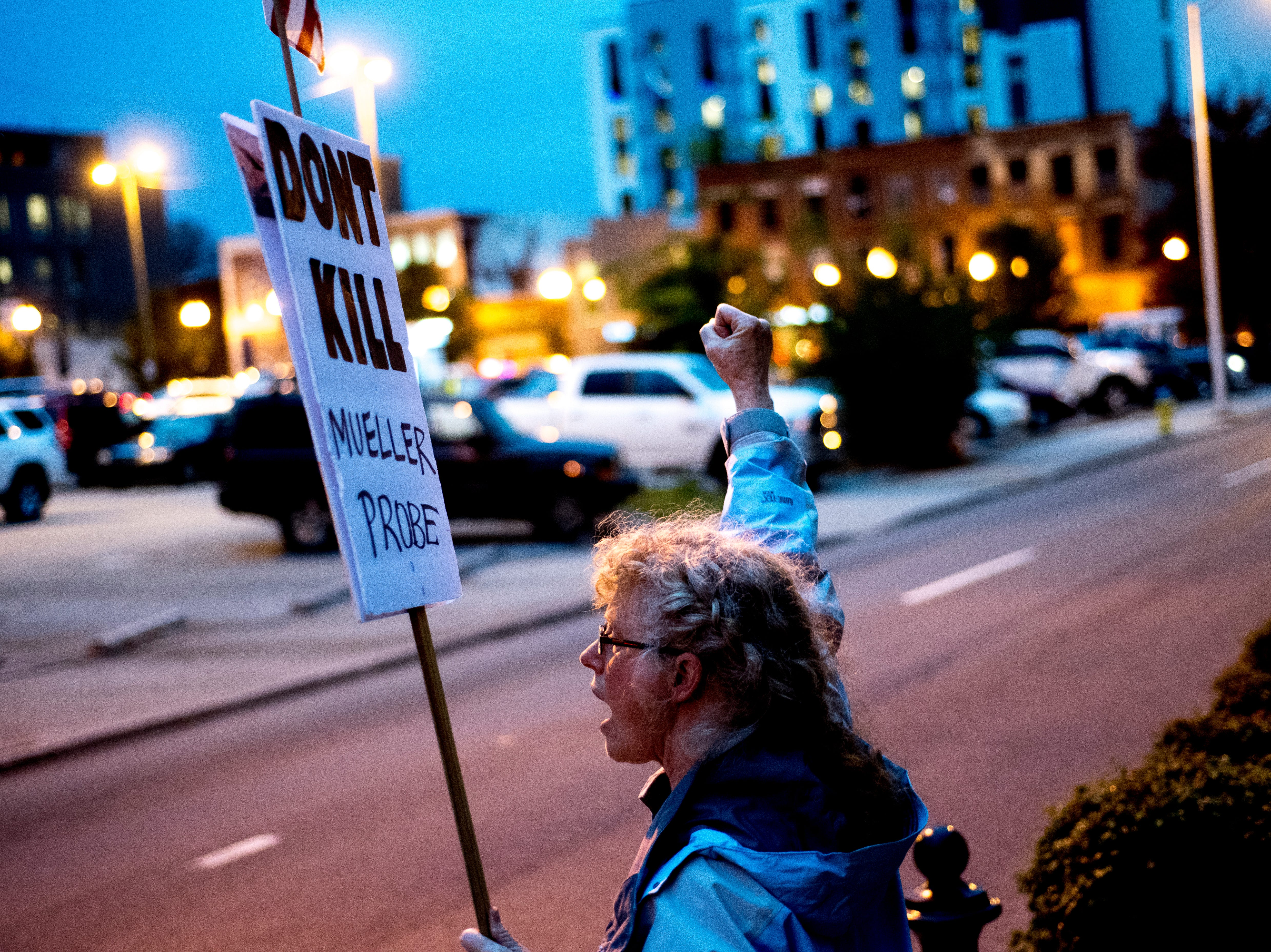 Linda Sharp, of Maryville, chants to passersby during a protest against the firing of United States Attorney General Jeff Sessions outside of the Federal Courthouse in Knoxville, Tennessee on Thursday, November 8, 2018.