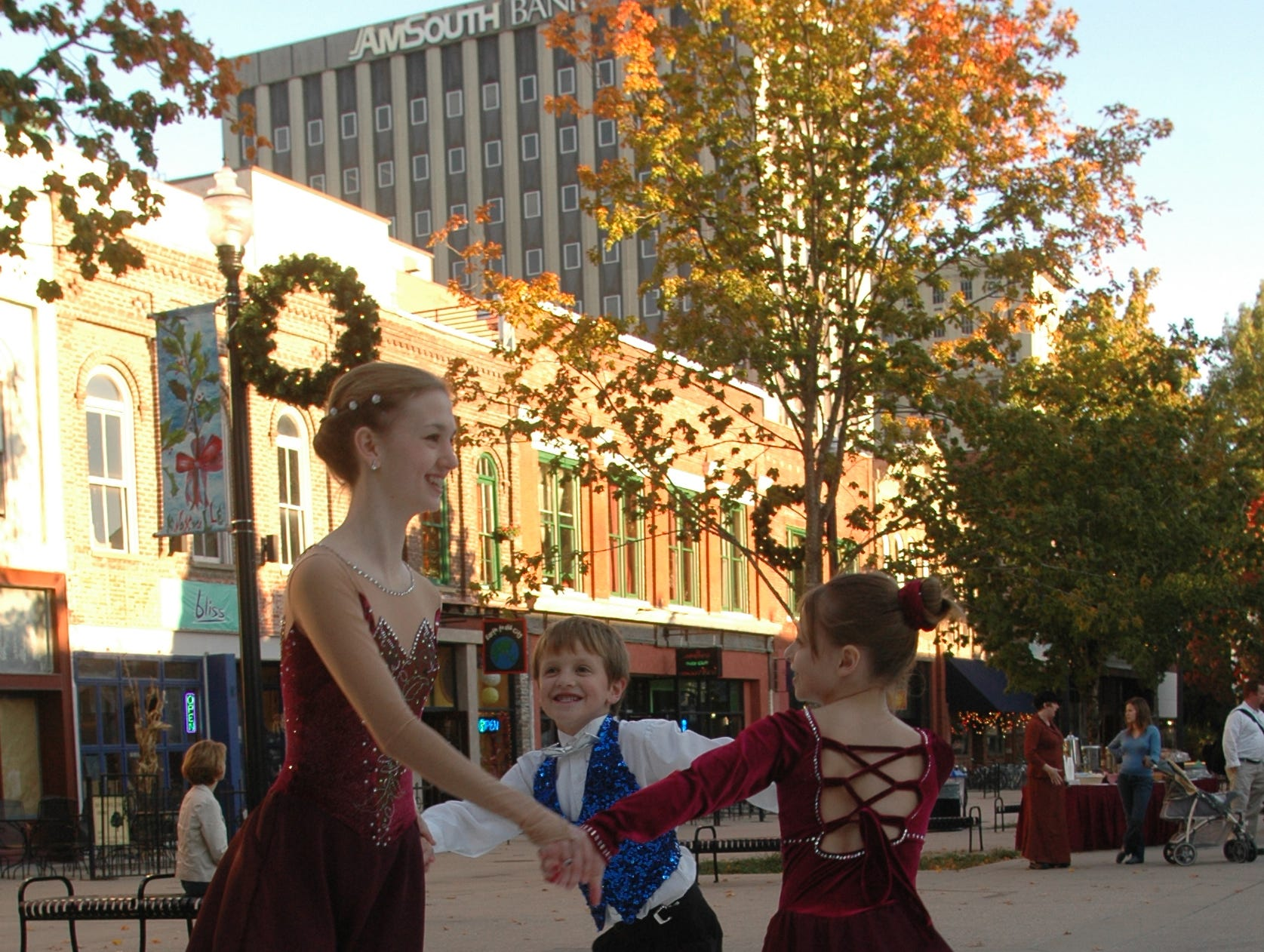 Kassandra Hazard (Left),14, Jack Varnon (Center), 6, and Rebecca Varnon (Right), 8, practice their skating moves before the announcement of Christmas in the City events Wednesday in Market Square. Among the holiday festivities announced by Knoxville Mayor Bill Haslam will be the return of an ice skating rink to Market Square.  10/02/05