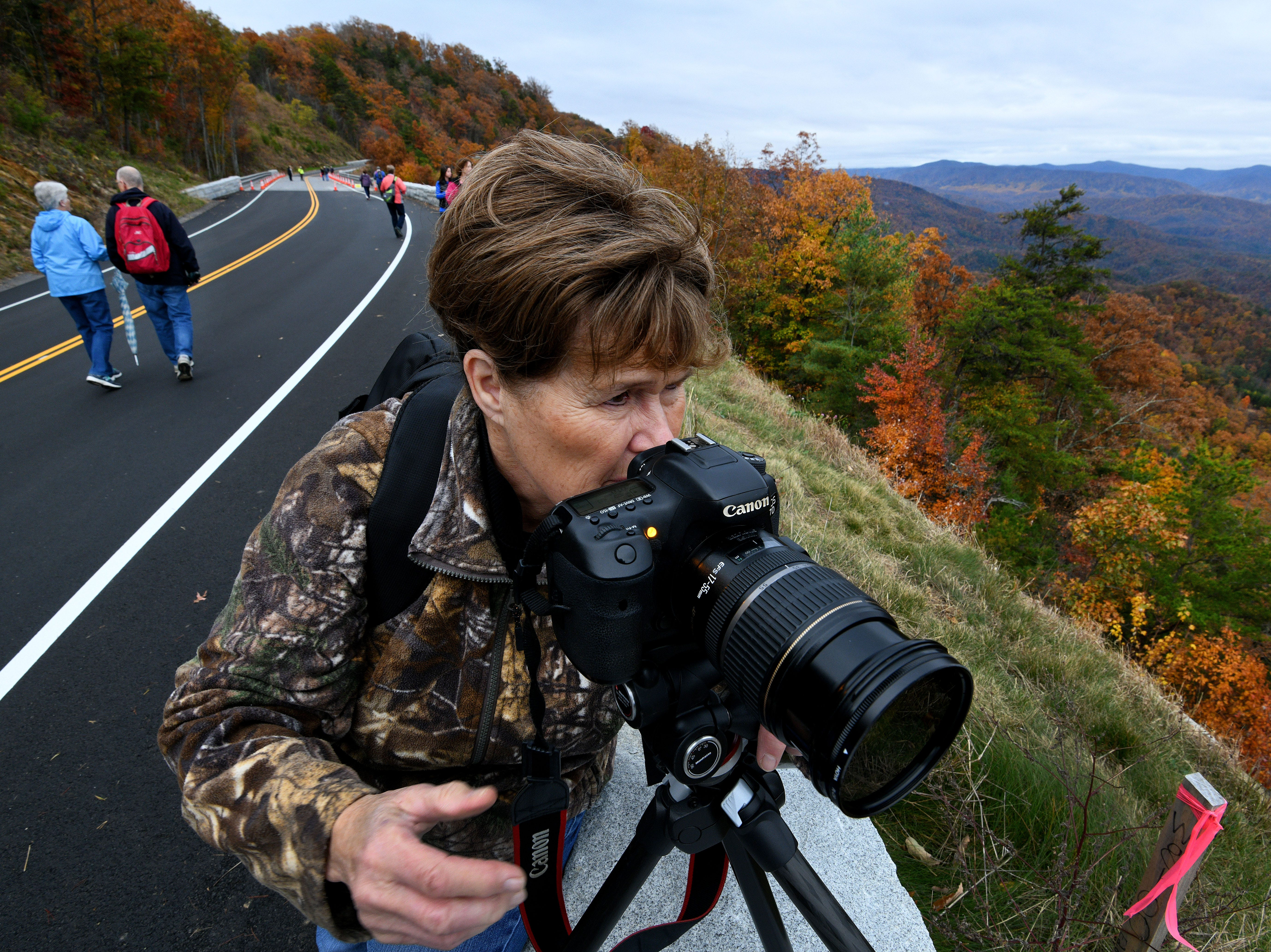 Jan Kitelynn from Maryville shoots photographs during the National Park Service Community Day Thursday, Nov. 8, 2018. The day was set aside for the public to experience the bridges along the 1.65-mile section known as the 'Missing Link' before it opens to motorists and cyclists Saturday.