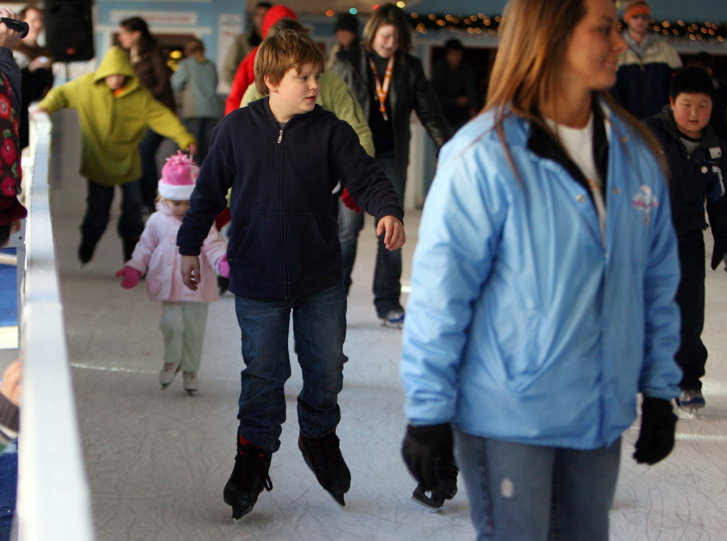 Ten year old Camruinn Morgan (cq), center,  glides along the ice skating rink on Market Square during Knoxville's Holidays on Ice on Friday, Nov. 27, 2009.