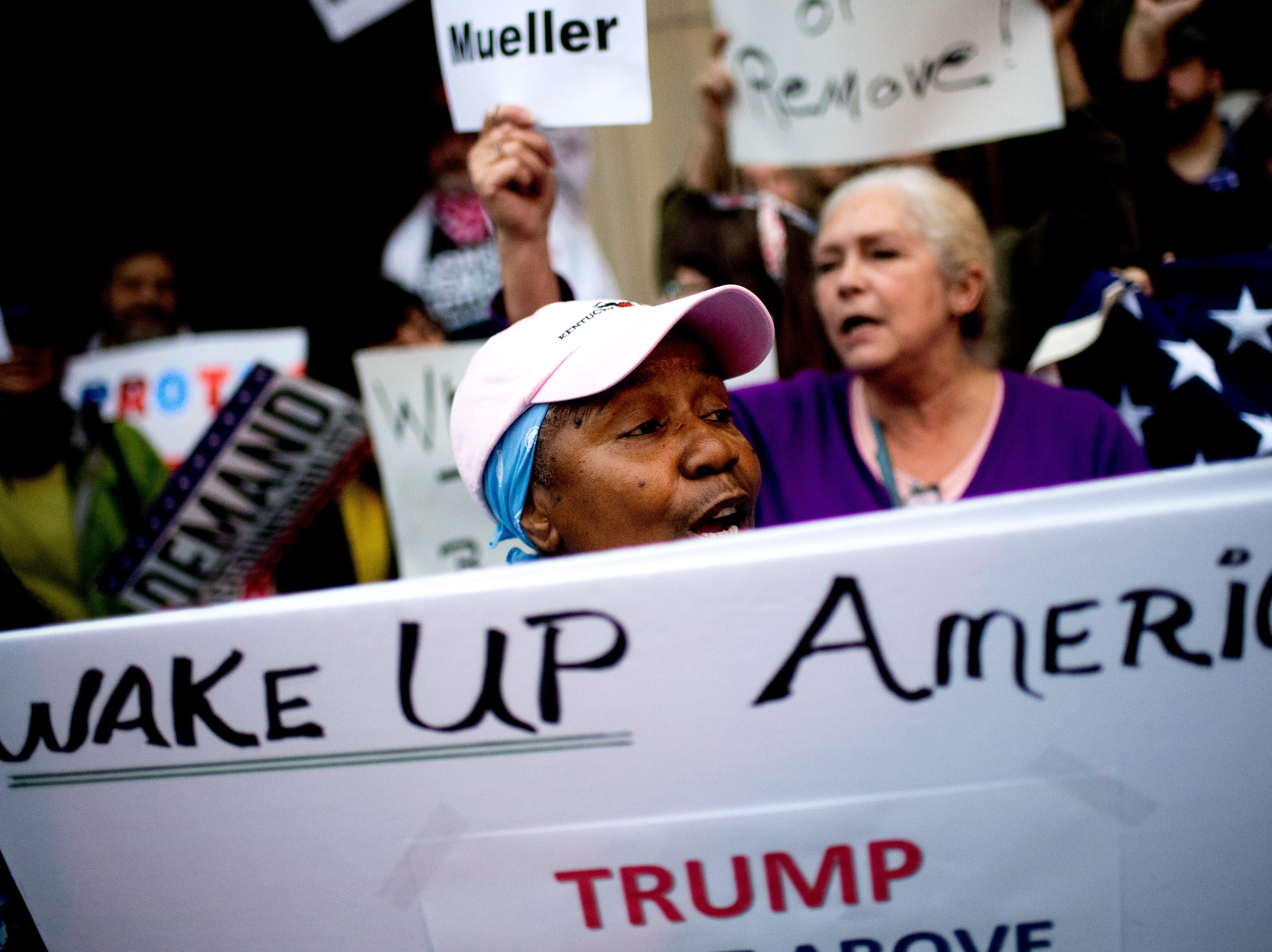 Jackie Hill, of Alcoa, chants during a protest against the firing of United States Attorney General Jeff Sessions outside of the Federal Courthouse in Knoxville, Tennessee on Thursday, November 8, 2018.