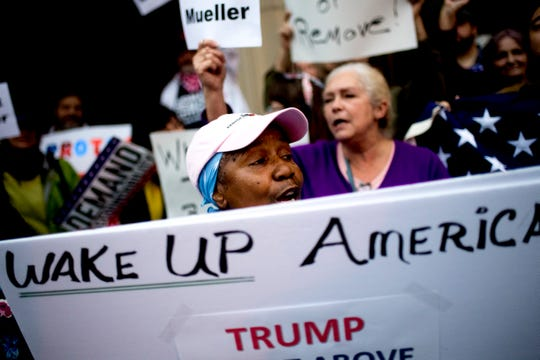 "Jackie Hill, of Alcoa, chants during a protest Thursday. She called new acting Attorney General Matthew Whitaker a ""sycophant who will do what Trump wants."""