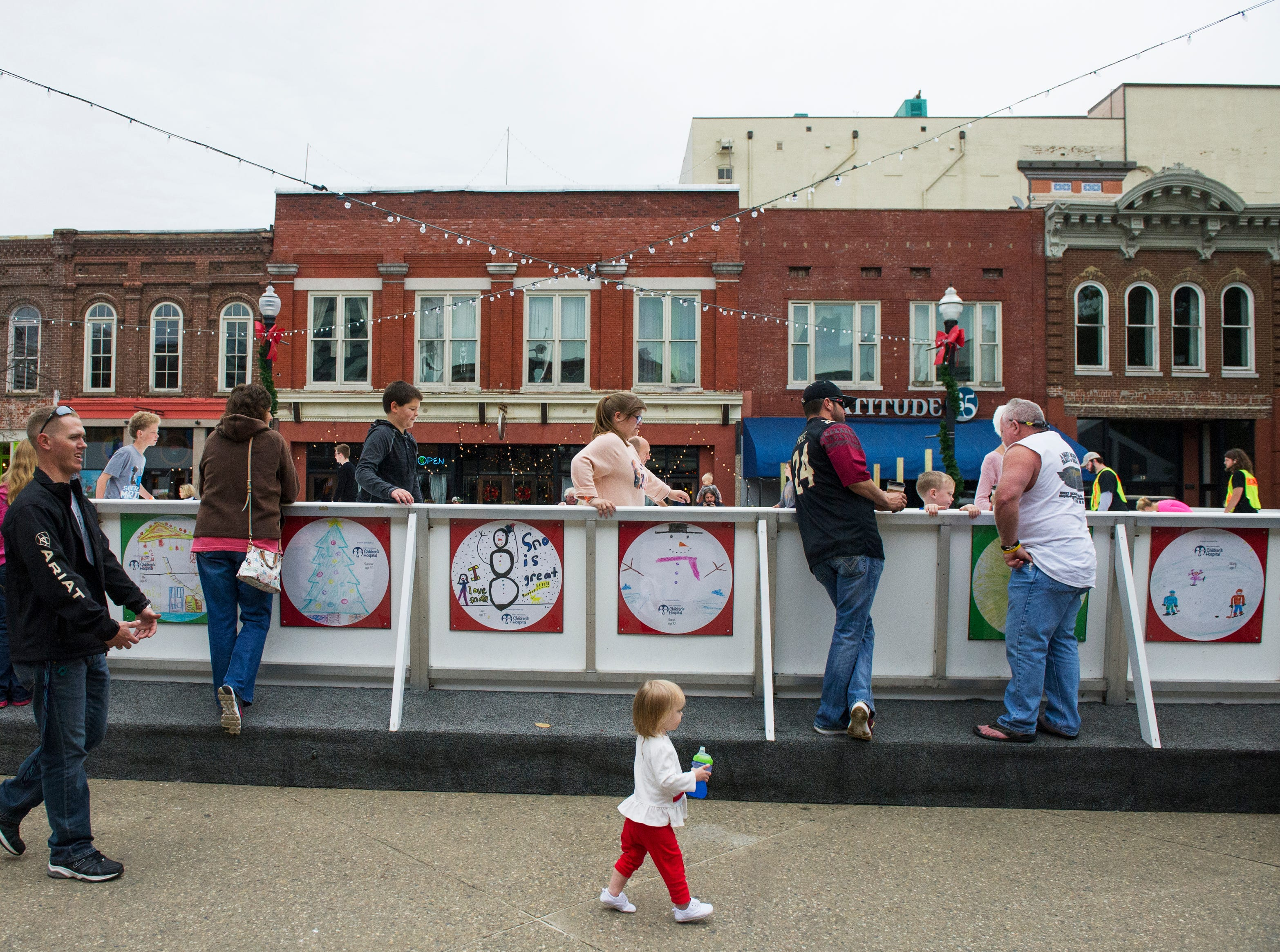 Families gather to enjoy the opening weekend for the Market Square ice skating rink Saturday, Nov. 28, 2015.