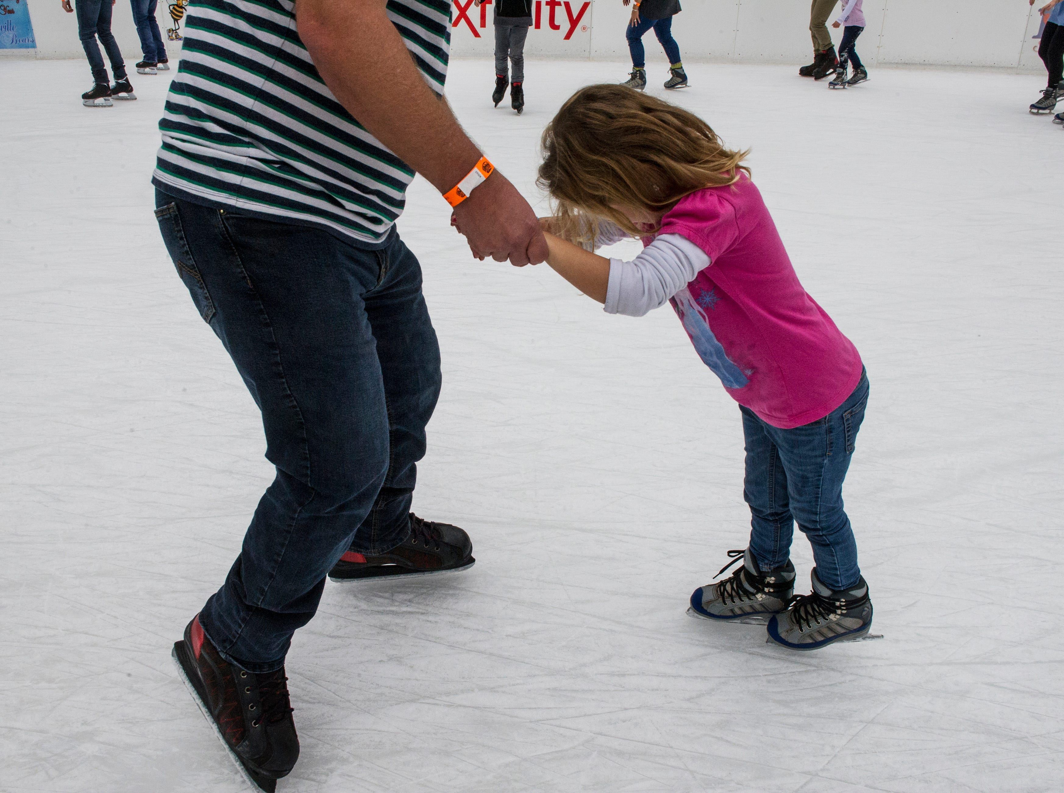 Skaters of all ages and skill levels make their way around the ice during opening weekend for the Market Square ice skating rink Saturday, Nov. 28, 2015.