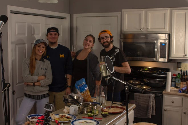 """Kyle Witt (far right) and friends cook up veggie fare on his podcast, """"Cookin' With Legs."""""""
