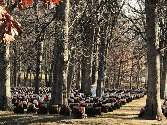 Wreaths placed on veteran grave sites at Indiana Veterans' Home Cemetery in West Lafayette.