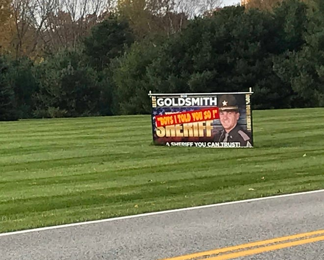 "A campaign sign along County Road 200 North seems to gloat over Bob Goldsmith's victory over Jason Dombkowski in Tuesday's close election for Tippecanoe County sheriff. A strip added to the sign after Goldsmith won reads: ""Boys I told you so!"" Goldsmith said he took down the sign after hearing about it Thursday morning."