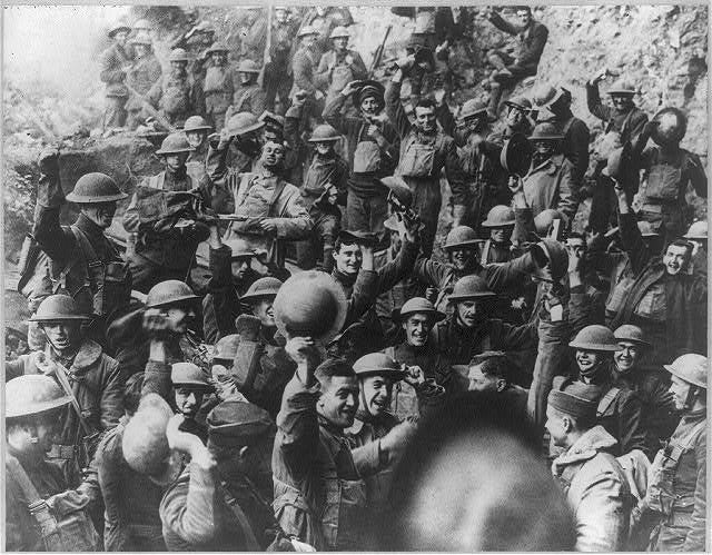 U.S. troops in France cheer the news about the armistice 100 years ago. The fighting stopped the 11th minute of the 11th hour of the 11th day of the 11th month. The fighting might have stopped on Nov. 11, 1918, but the peace wasn't signed until June 1919.