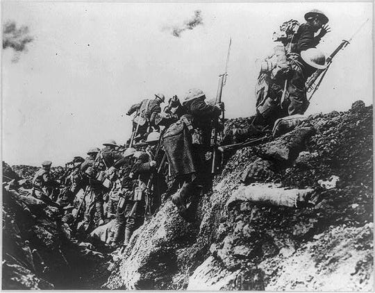 American soldiers climb up and out of their trenches in 1918 in an attack against German lines. The guns fell silent on Nov. 11, 1918, at the 11th minute of the 11th hour. The peace, however, wasn't signed until June 1919.