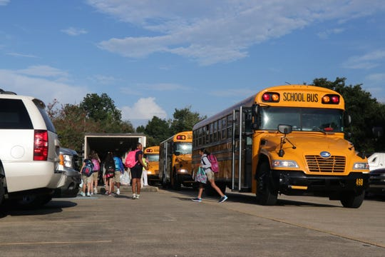 Students get off the bus for the first day of school in 2017 at L.J. Alleman Middle.