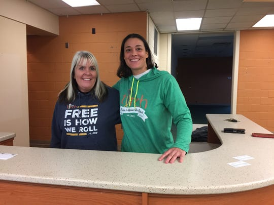 Torch 180 founders, from left, Rhonda Callanan and Sarah Ruddle stand behind what used to be the circulation desk at the Fowlerville District Library, Thursday, Nov. 8, 2018. It will be a coffee bar in the restaurant and training facility for people who are disabled they plan to open next summer.