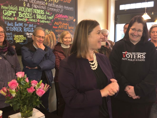 Newly-elected 8th District U.S. Rep. Elissa Slotkin speaks to constituents at Great Harvest Bread Company in Brighton on Thursday, Nov. 8, 2018.