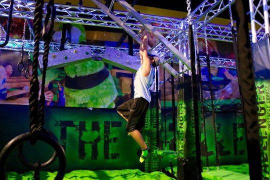 A youngster works his way through the ninja course at Launch Trampoline Park.