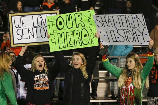 Reedsville students hold up signs honoring Jevon Lemke during a first-round WIAA Division 7 playoff game against Suring at Reedsville High School Oct. 19 in Reedsville.