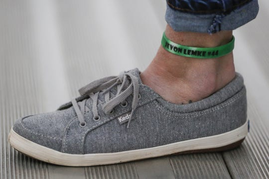 Carrie Holton, Jevon Lemke's mother, wears a green bracelet around her ankle in memory of her son Wednesday in Reedsville.
