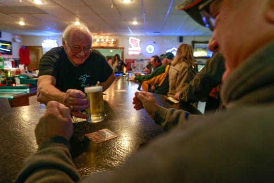 Owner Duane Bohman serves a customer Friday, Oct. 12, 2018, at The Fresh Country Aire restaurant in the Marathon County town of Day.