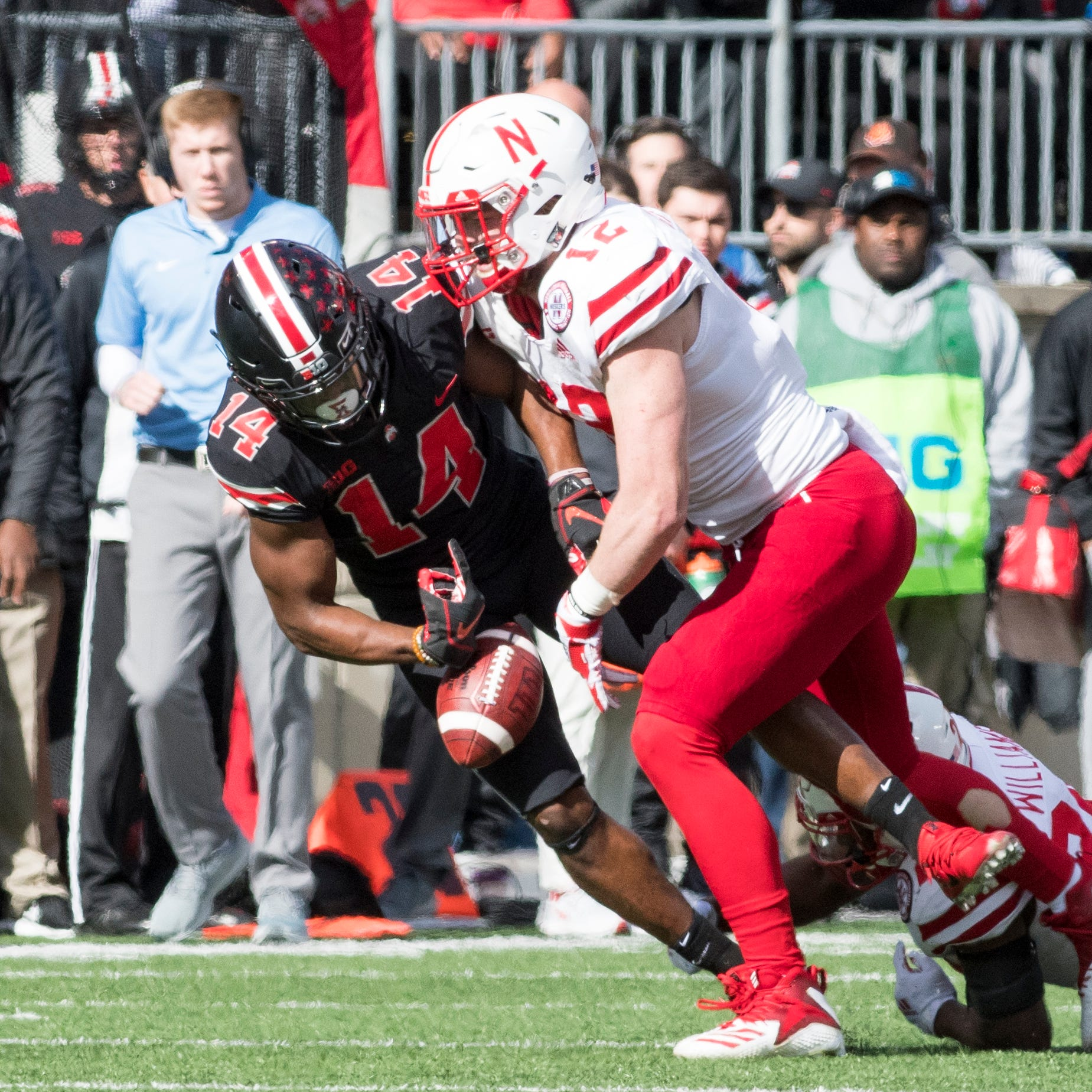 The usually sure-handed K.J. Hill loses control of the football, one of three turnovers Ohio State suffered in its 36-31 win over Nebraska