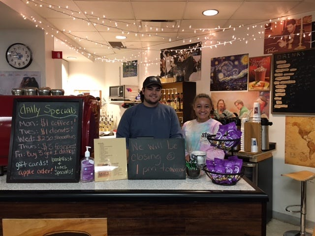 Keaton Sanjur, a student at The Ohio State Univerity Mansfield, operates Keat's Coffee inside the lobby of OhioHealth Mansfield Hospital. In the photograph with him is employee Alexis Boyd.