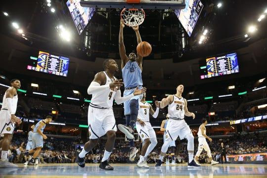 Memphis Grizzlies forward Jaren Jackson Jr. dunks the ball over Denver Nuggets forward Paul Millsap during their game at the FedExForum on Wednesday, November 7, 2018.