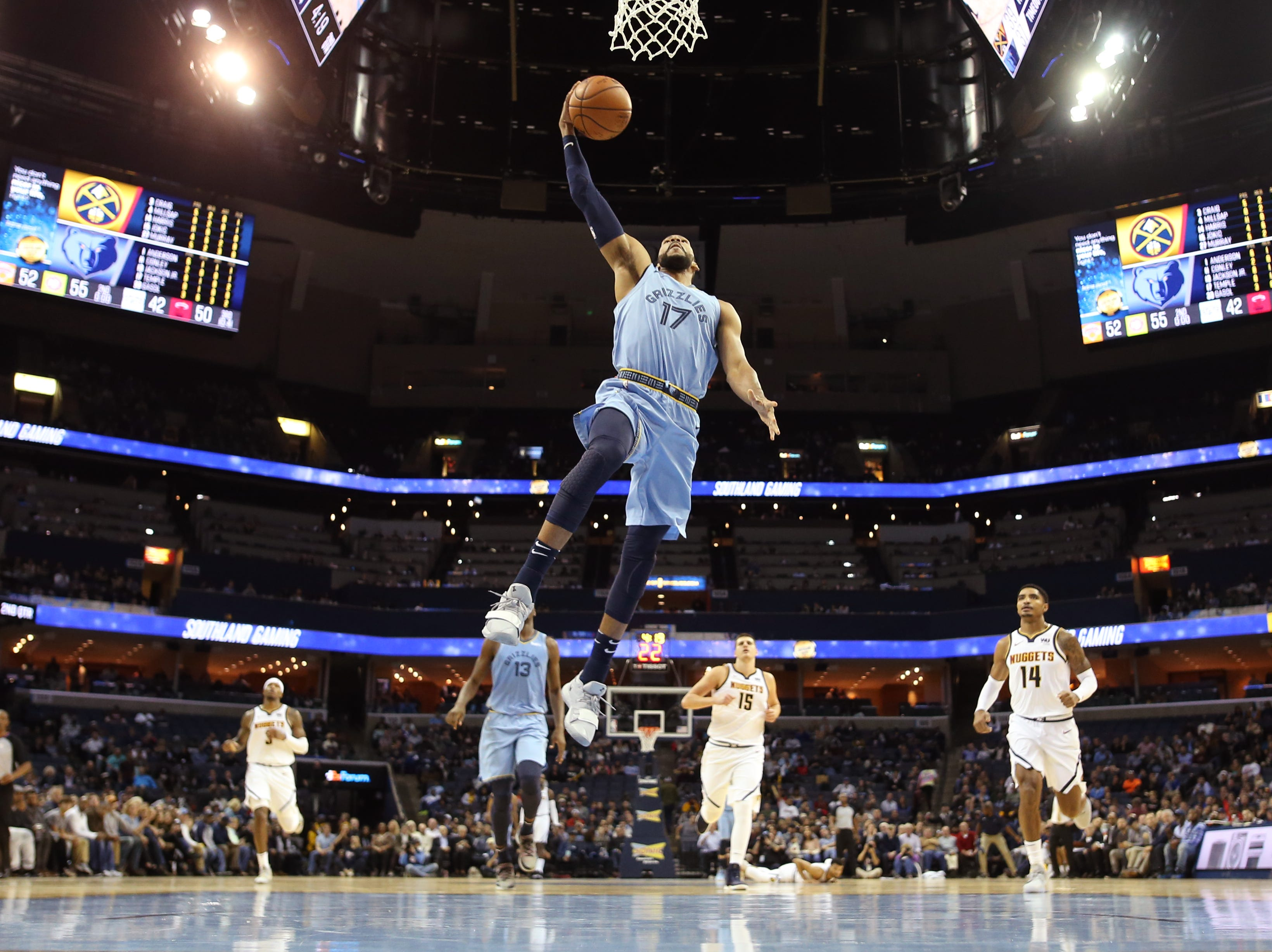 Memphis Grizzlies guard Garrett Temple dunks the ball on a fast break against the Denver Nuggets during their game at the FedExForum on Wednesday, November 7, 2018.