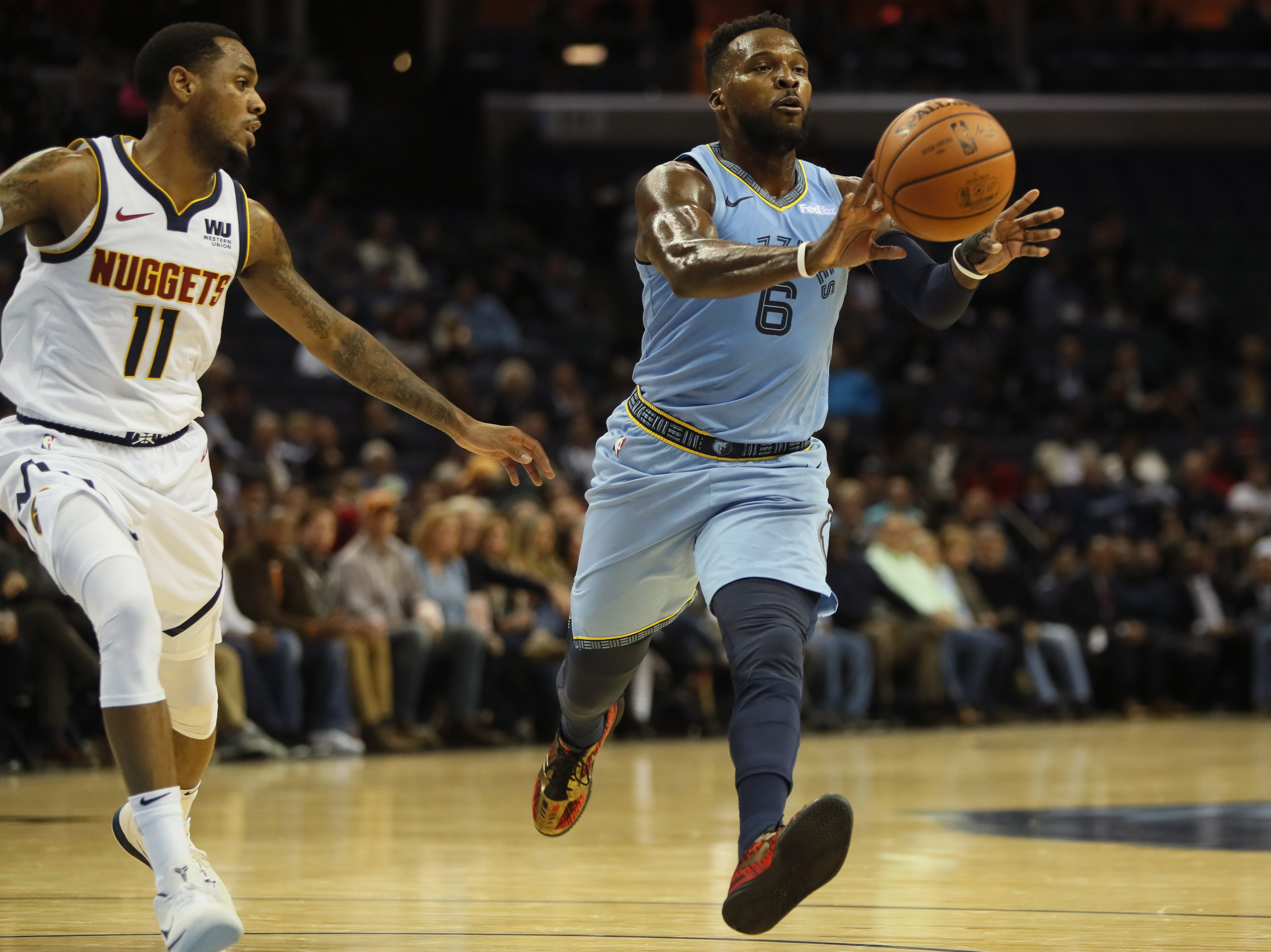 Memphis Grizzlies guard Shelvin Mack passes the ball against the Denver Nuggets during their game at the FedExForum on Wednesday, November 7, 2018.