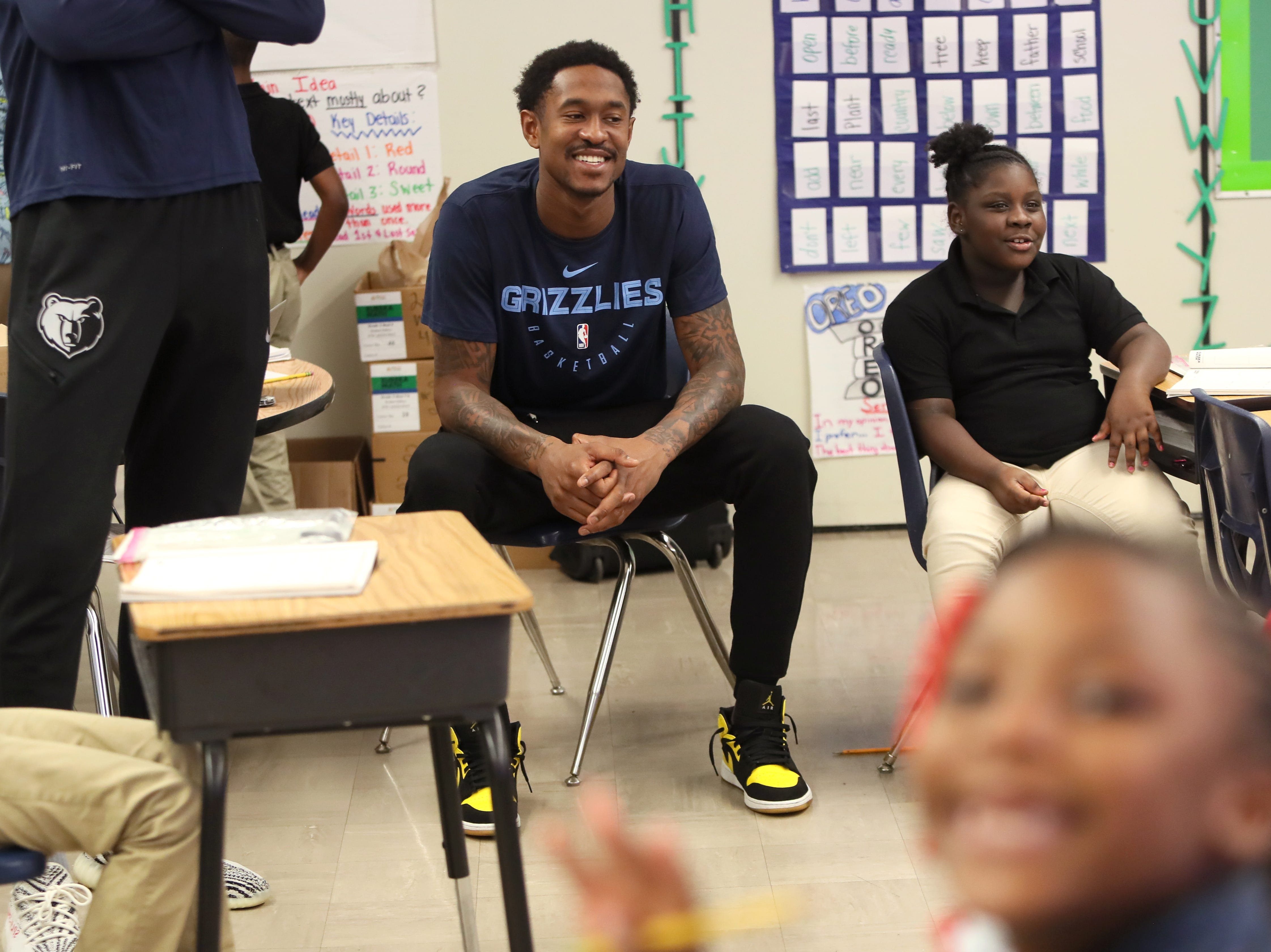 Memphis Grizzlies' MarShon Brooks surprises a classroom as his team, FedEx and Operation Warm surprise children with new coats at Hawkins Mill Elementary School on Thursday, Nov. 8, 2018.