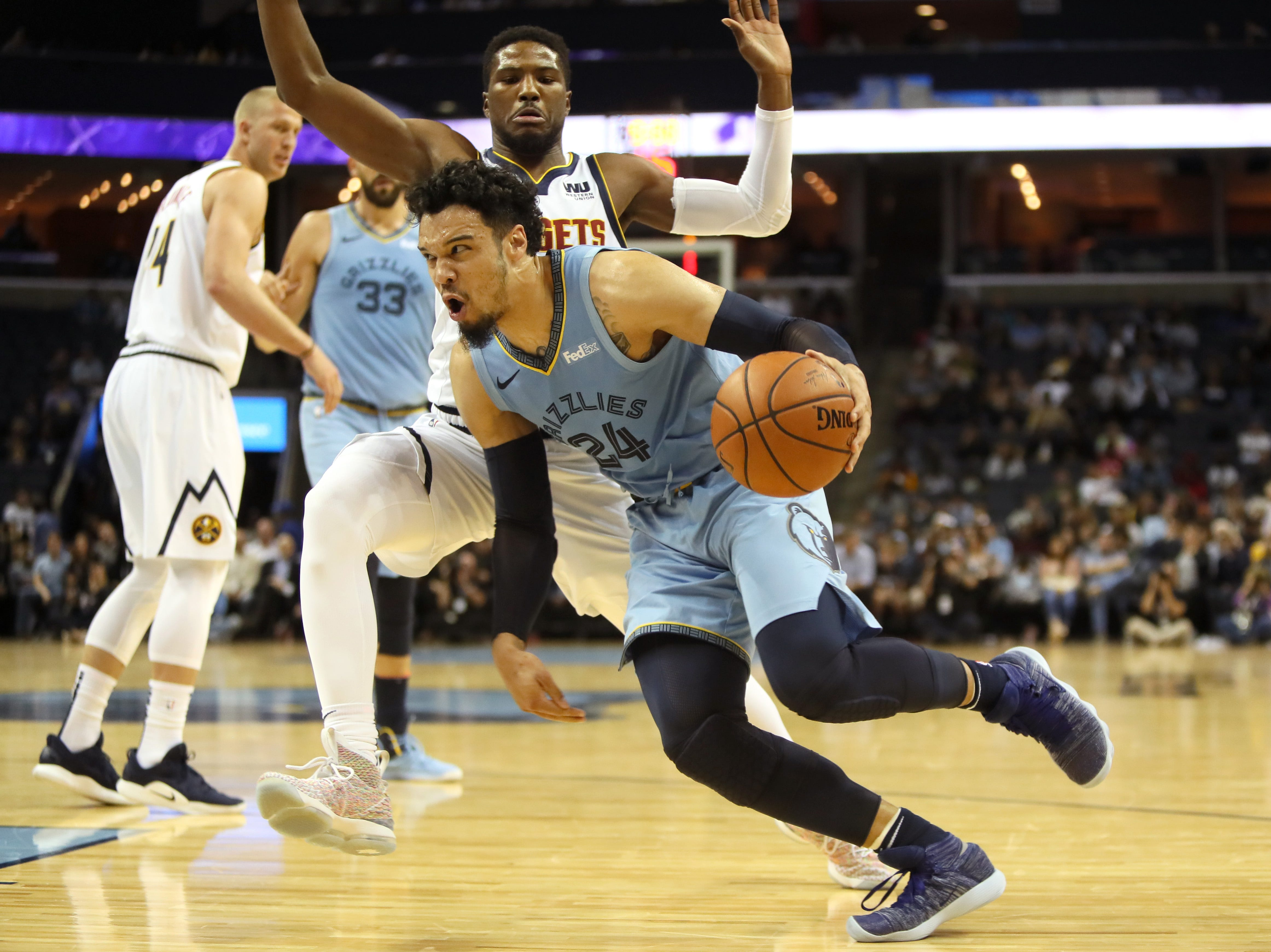 Memphis Grizzlies guard Dillon Brooks drives past Denver Nuggets guard Malik Beasley during their game at the FedExForum on Wednesday, November 7, 2018.