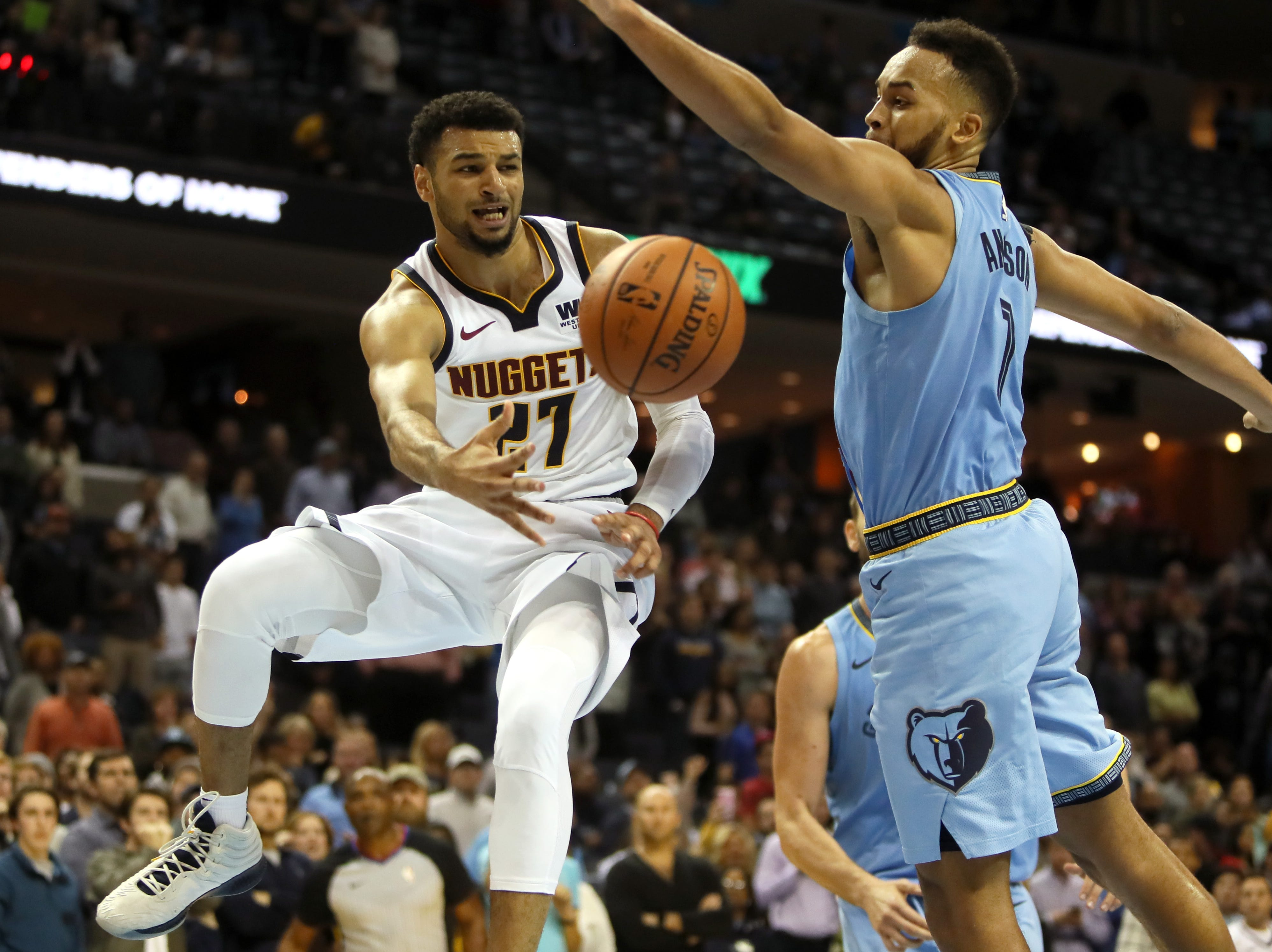 Denver Nuggets guard Jamal Murray passes the ball past Memphis Grizzlies guard Ryan Anderson during their game at the FedExForum on Wednesday, November 7, 2018.