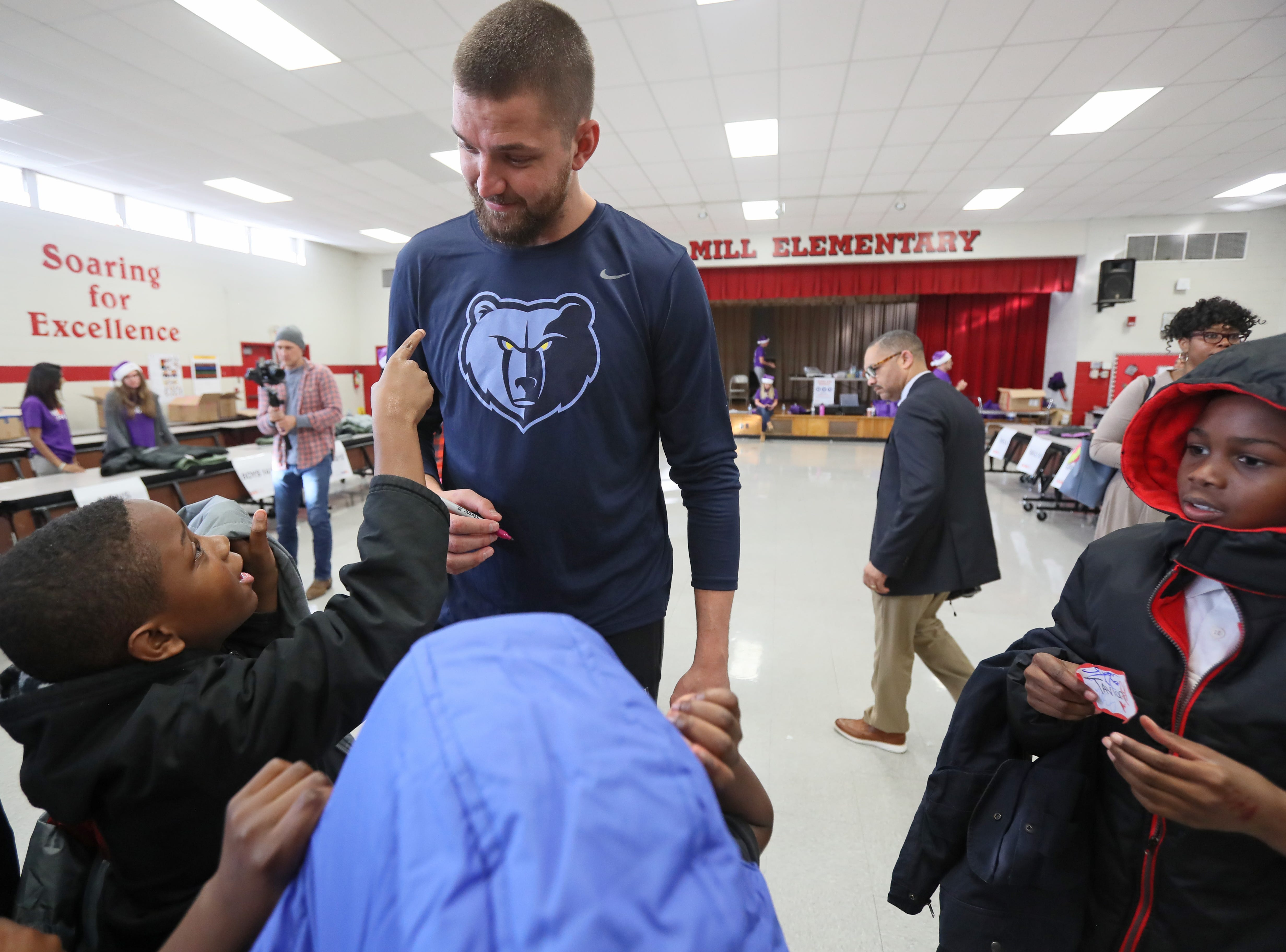 Memphis Grizzlies forward Chandler Parsons signs autographs as his team joins FedEx and Operation Warm to help surprise children with new coats at Hawkins Mill Elementary School on Thursday, Nov. 8, 2018.