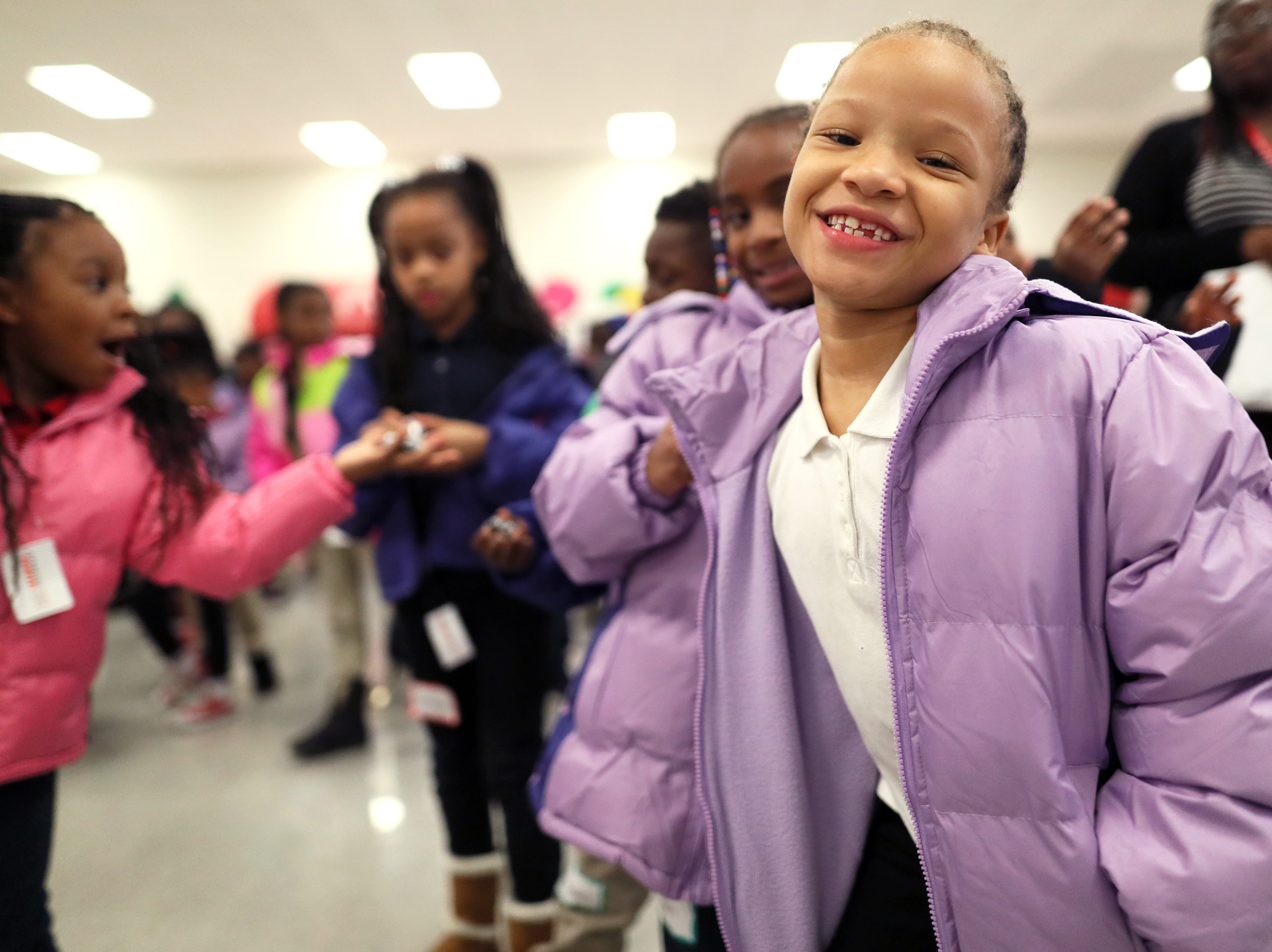 Lencia Neal, 7, sports her new winter wear as FedEx, the Memphis Grizzlies and Operation Warm surprised children with new coats at Hawkins Mill Elementary School on Thursday, Nov. 8, 2018.