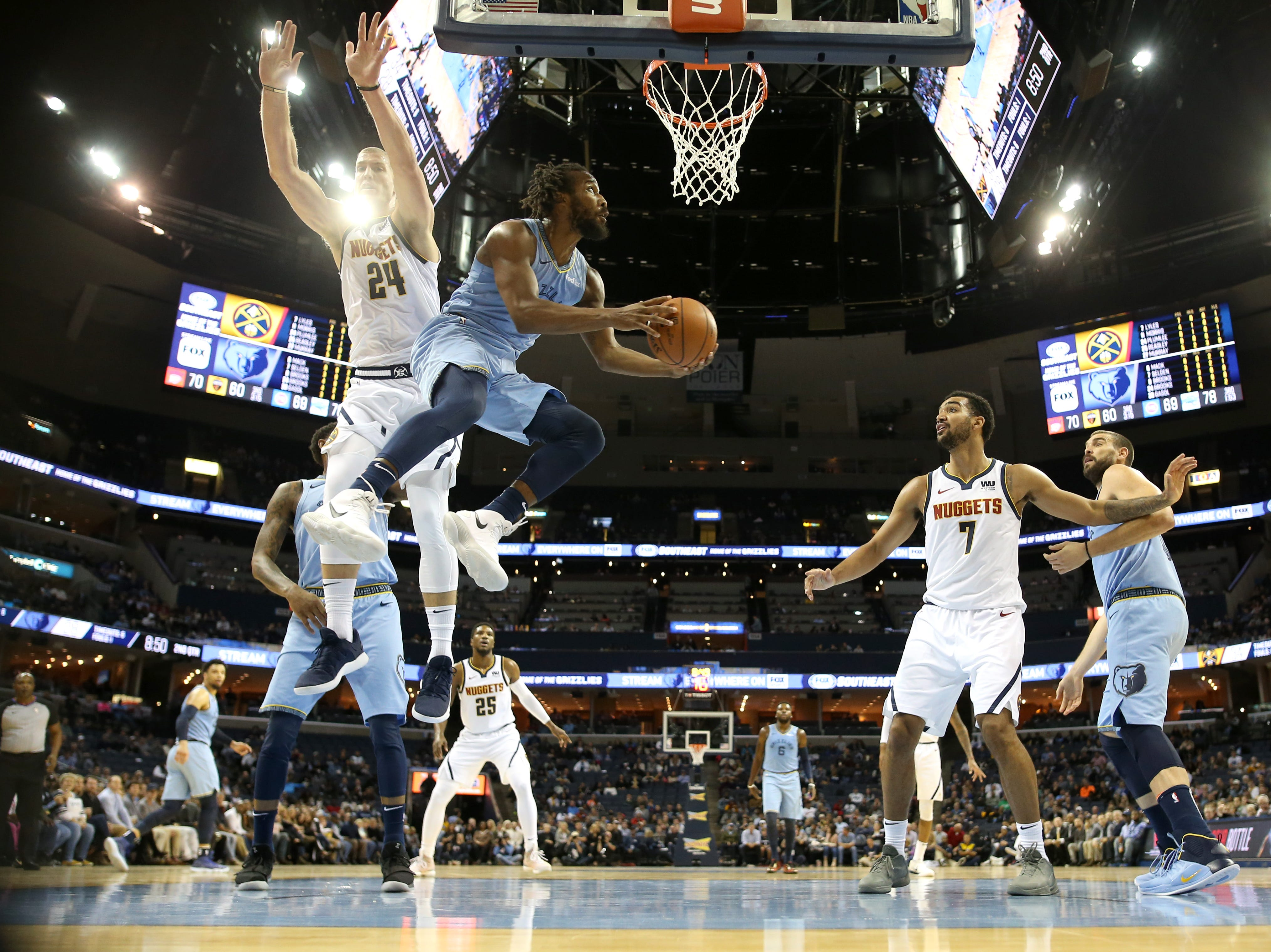 Memphis Grizzlies guard Wayne Selden is fouled while trying to manuver around Denver Nuggets forward Mason Plumlee for a layup during their game at the FedExForum on Wednesday, November 7, 2018.