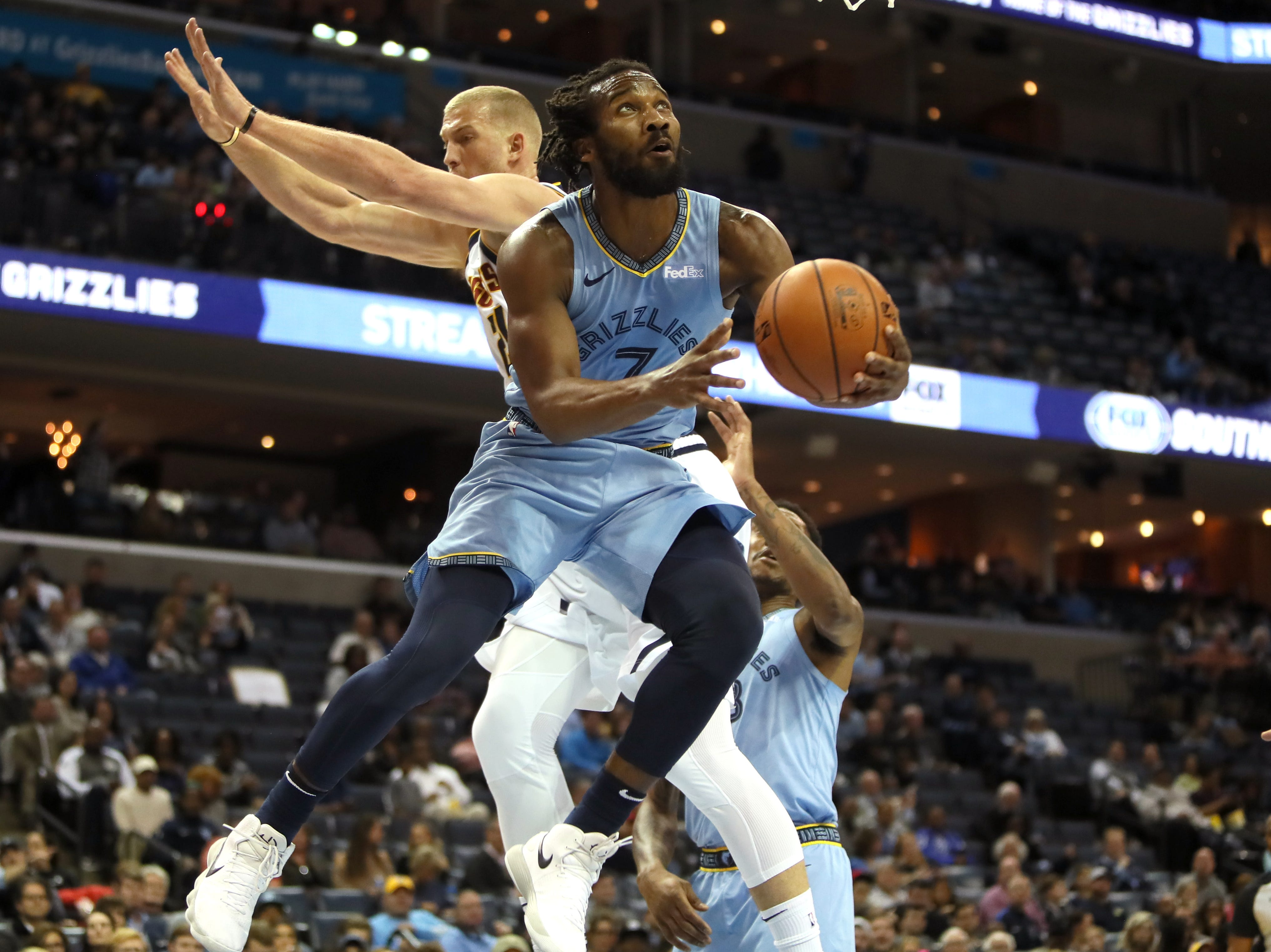 Memphis Grizzlies guard Wayne Selden lays the ball up past Denver Nuggets forward Mason Plumlee during their game at the FedExForum on Wednesday, November 7, 2018.