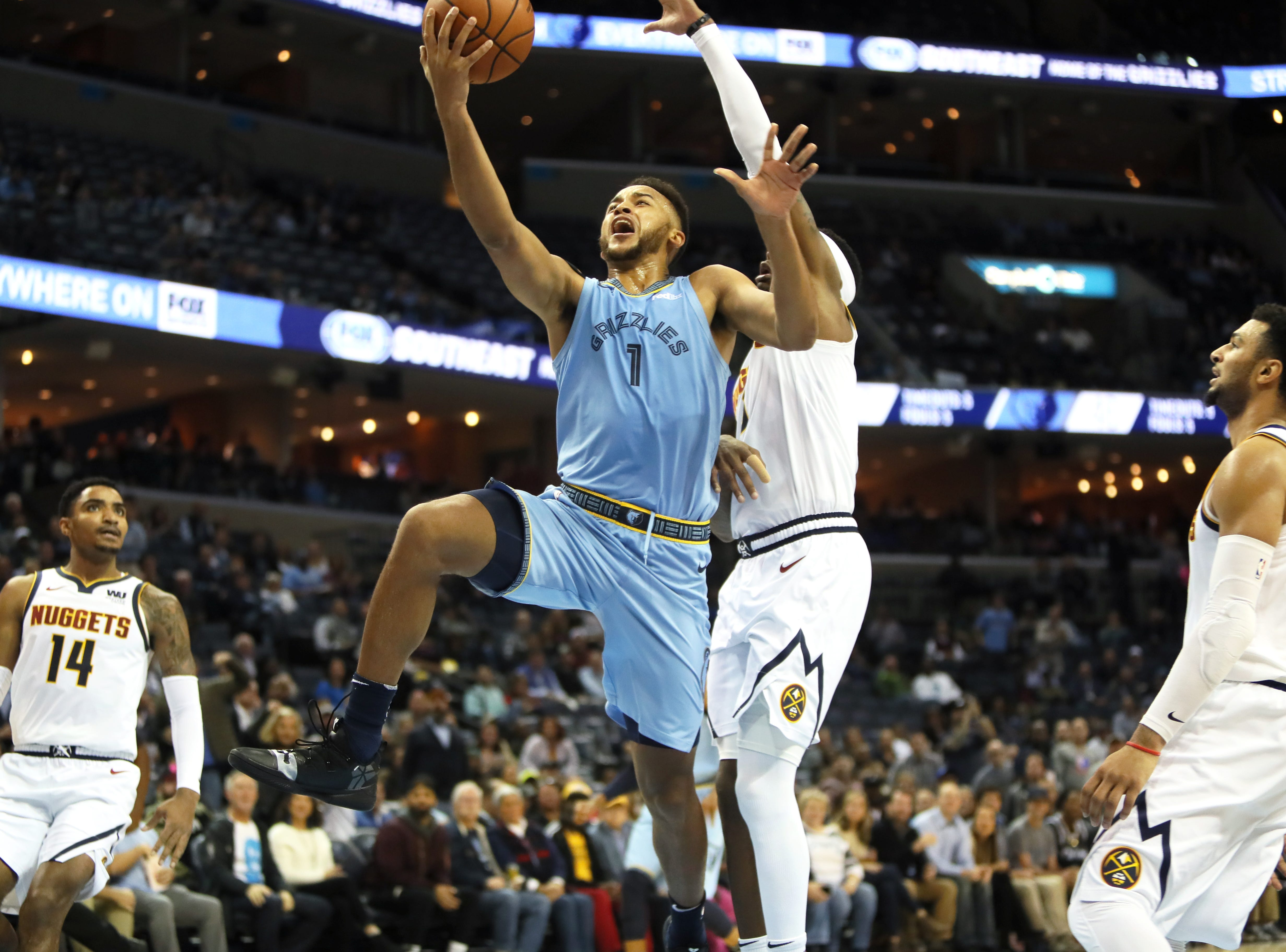 Memphis Grizzlies guard Ryan Anderson lays the ball up past Denver Nuggets forward Torrey Craig during their game at the FedExForum on Wednesday, November 7, 2018.