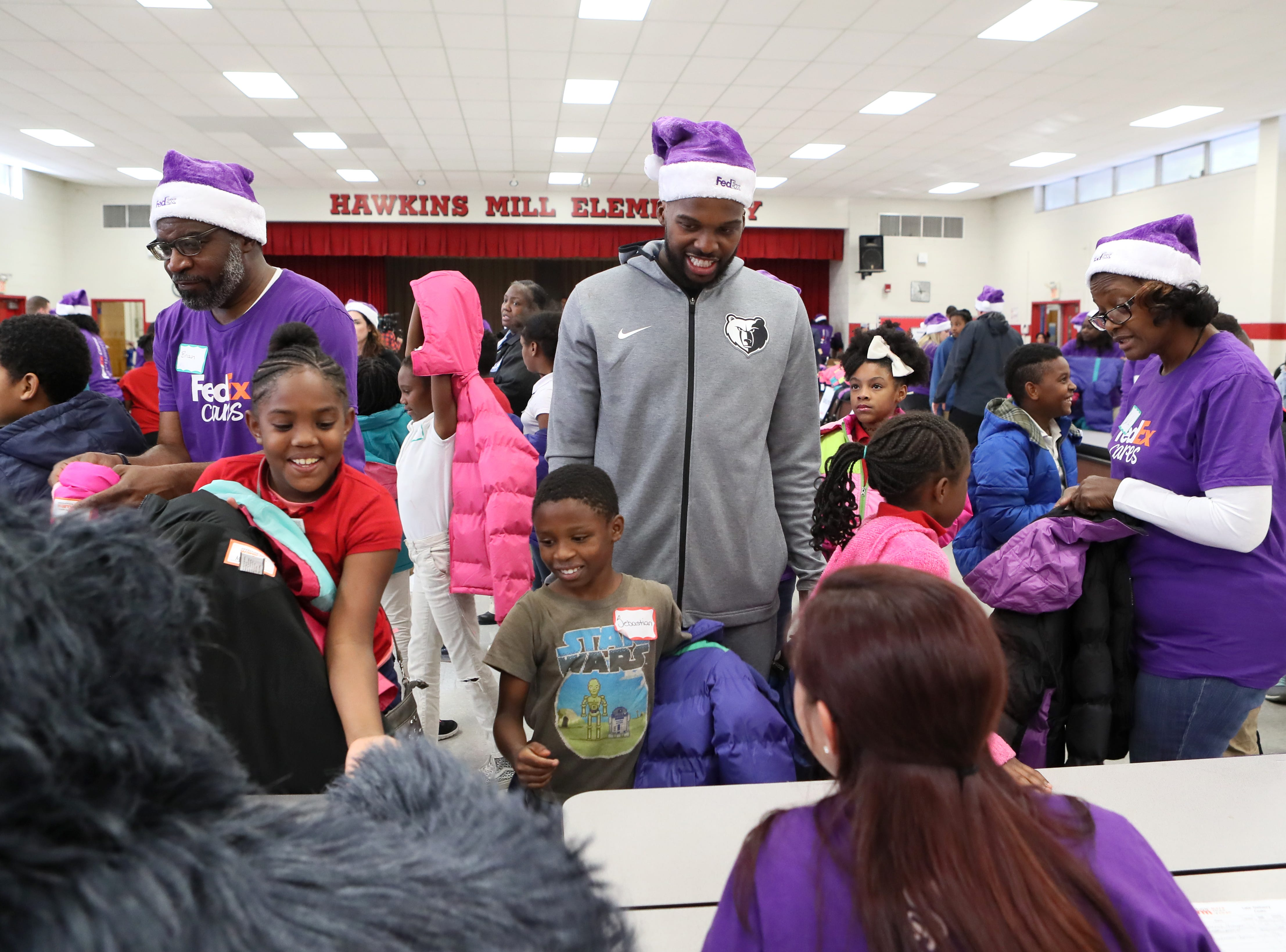 Memphis Grizzlies guard Shelvin Mack joins FedEx and Operation Warm to help surprise children with new coats at Hawkins Mill Elementary School on Thursday, Nov. 8, 2018.