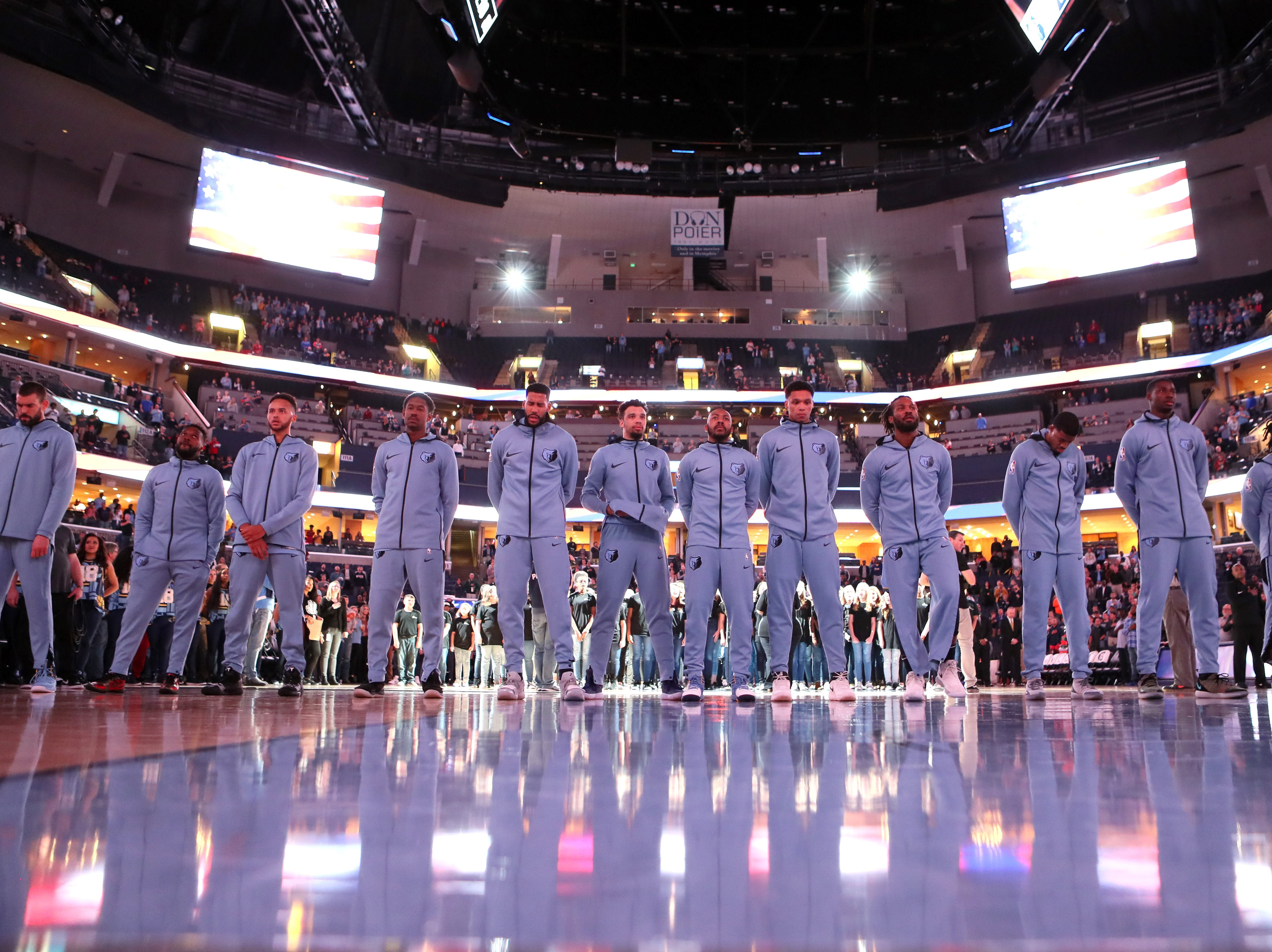Memphis Grizzlies players stand for the National Anthem before their game against the Denver Nuggets at the FedExForum on Wednesday, November 7, 2018.