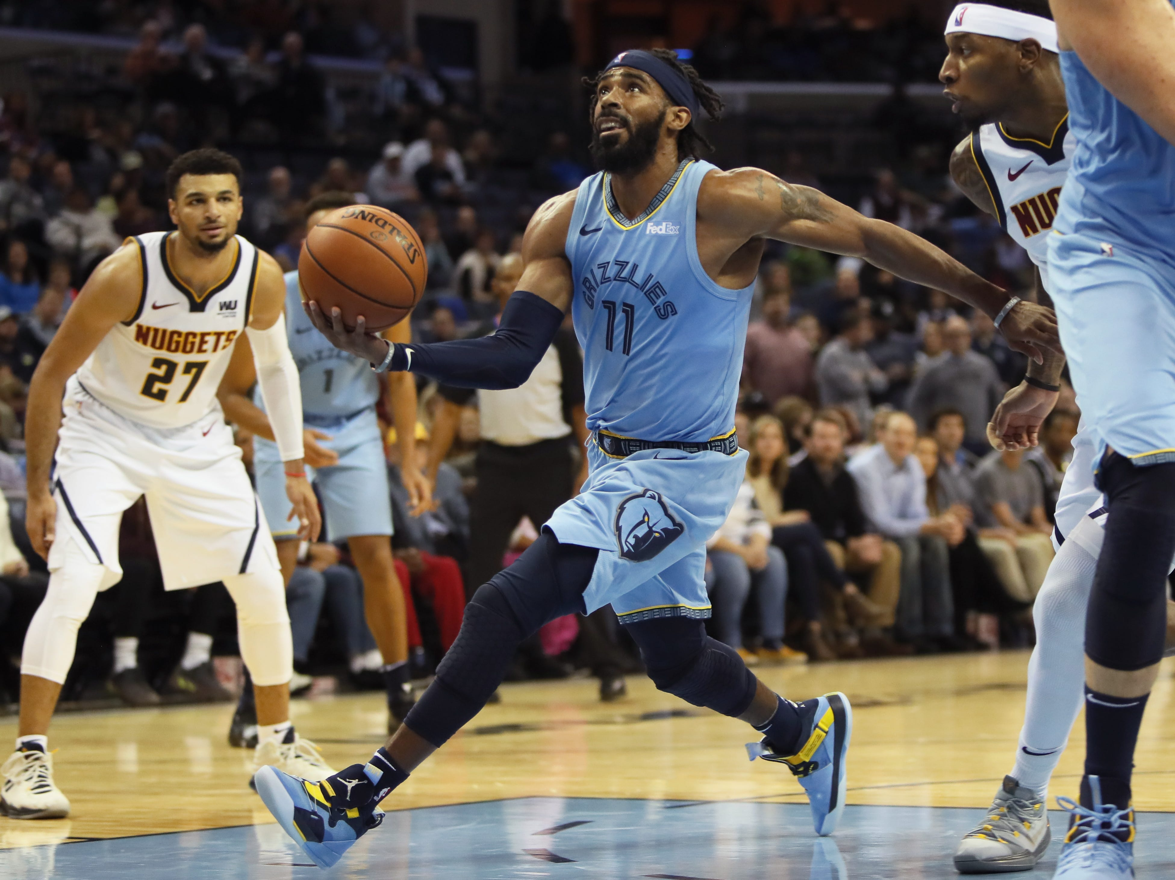 Memphis Grizzlies guard Mike Conley drives the lane against the Denver Nuggets during their game at the FedExForum on Wednesday, November 7, 2018.